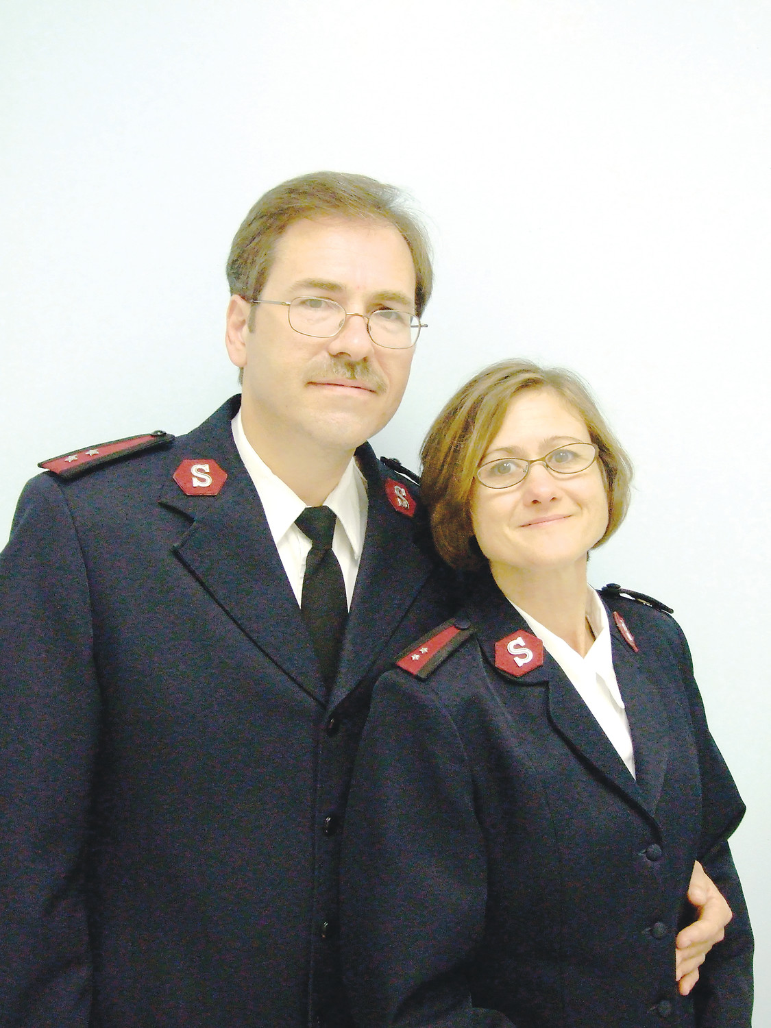 Captain Mark Czanderna, with wife Sherry, is fluent in several languages and ready to learn more.
