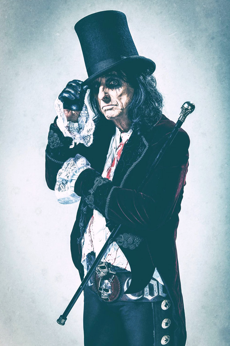 8394e690cec ALICE COOPER dresses in suits and jackets that contrast to the macabre  setting of his concerts