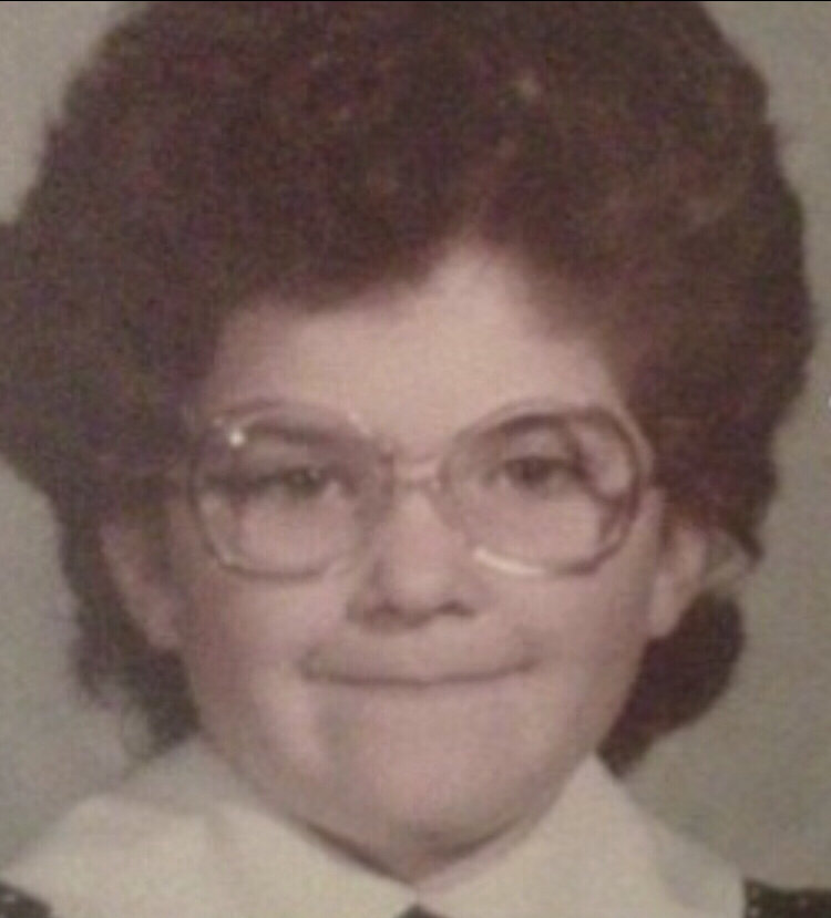 Virginia Beach, VA—I decided to send my picture in, because I know that my picture is sure to brighten everyone's day. This is my kindergarten school picture. I was  4 years old, looking like I was 65.
