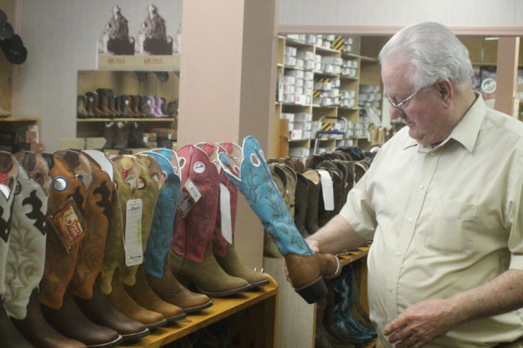Bob Reagan sells approximately 200 styles of women's boots at his Western wear store off West Brewington Road. Reagan says that boots are the most popular piece of Western wear that women have bought from him, as he has seen interest in women's boots increase within the past four years.