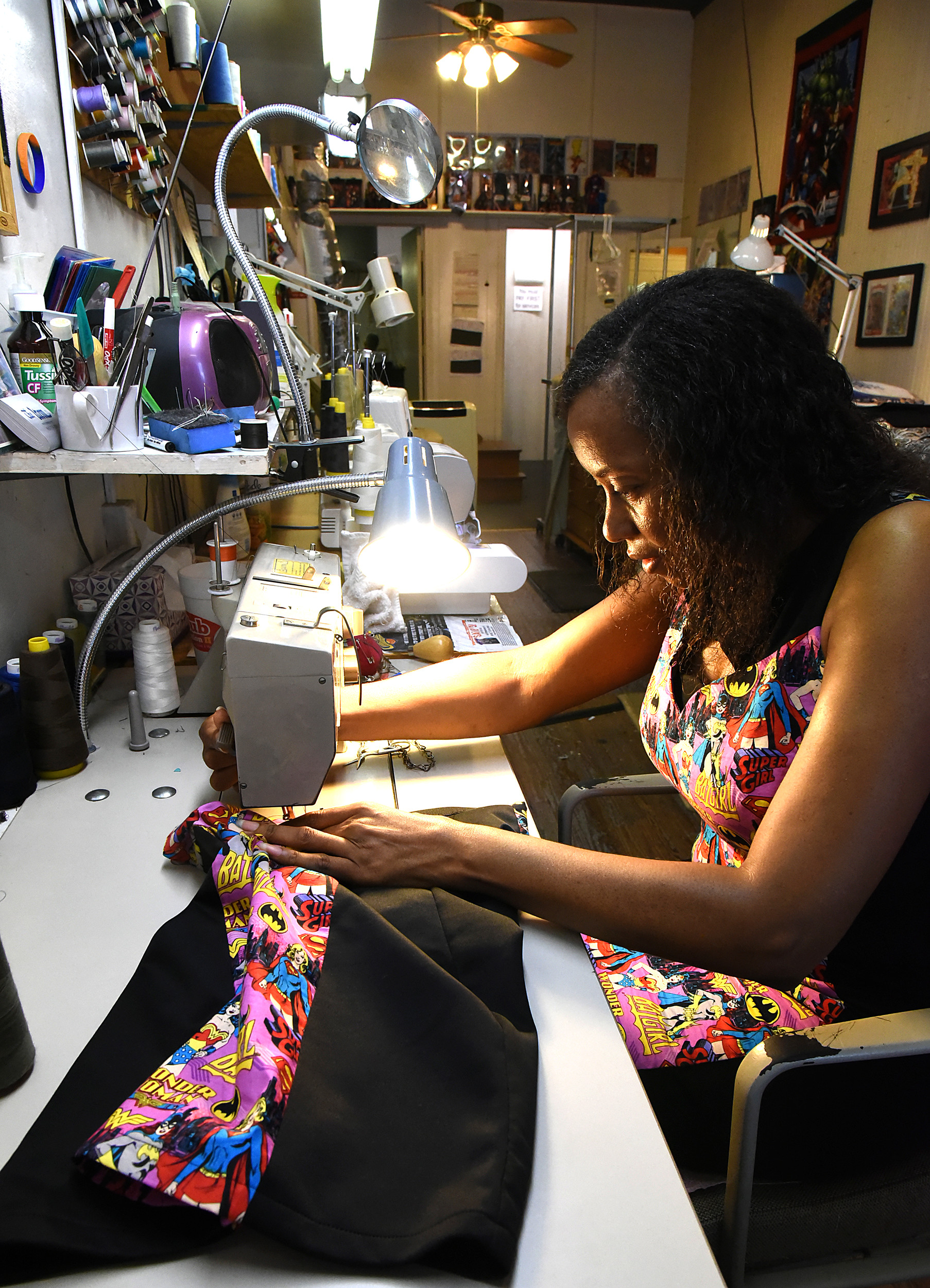 a8d2daf6ce4fe Excel Alterations tailor fits your clothes. Wendy Burroughs, owner of Excel  Alterations, sews a skirt hem for a friend with
