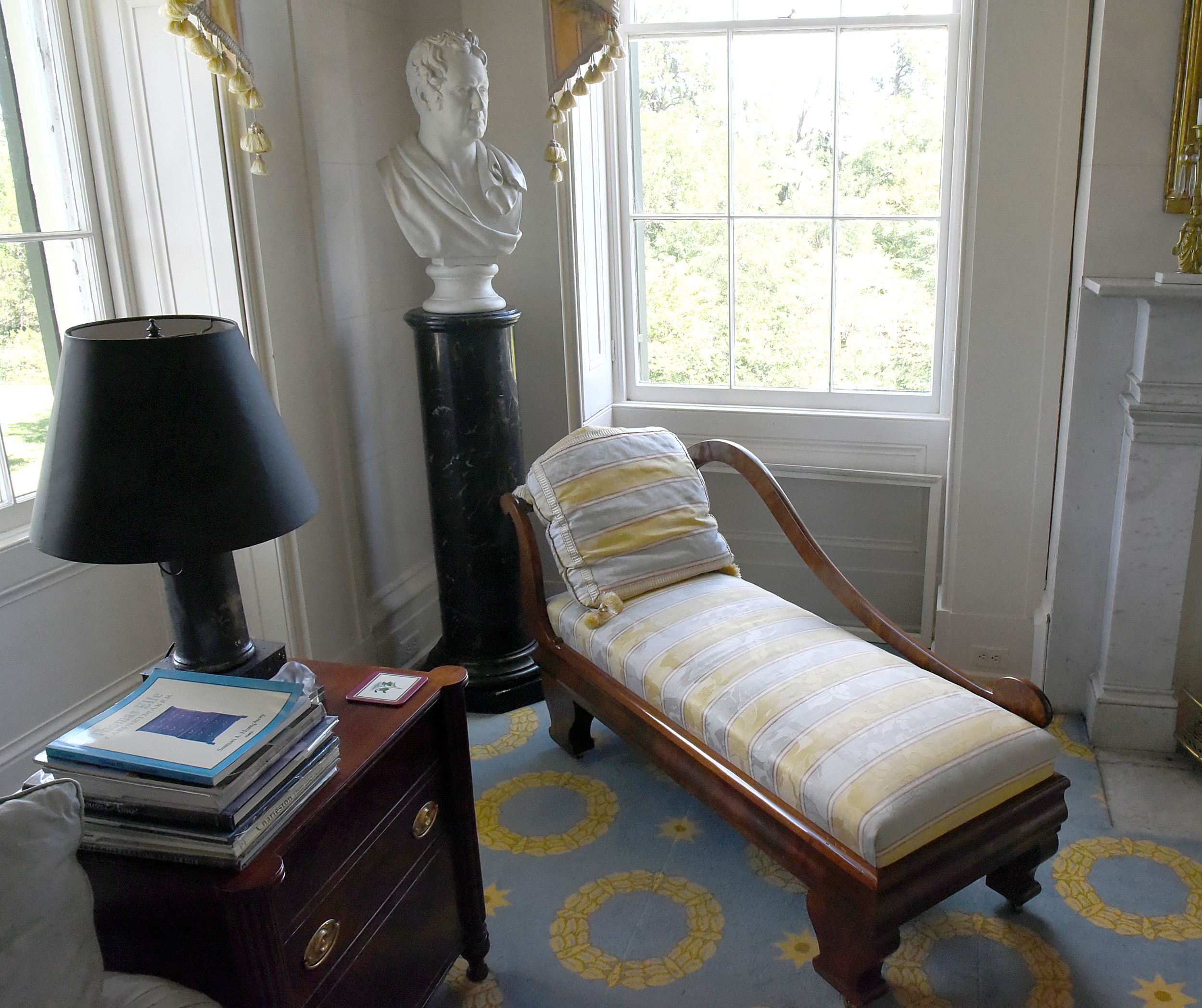 A bust overlooks a reading area in one of the rooms in the Millford Plantation house.