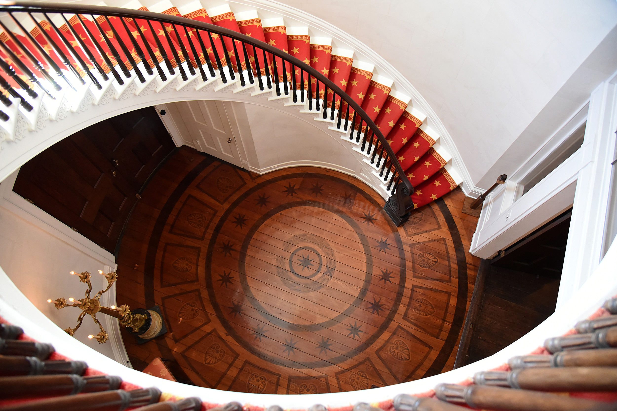 From atop a circular staircase in Millford Plantation, you can see detail from woodwork that is 175 years old that even allows heat to ventilate from the floor, something new when the home was built in 1841.