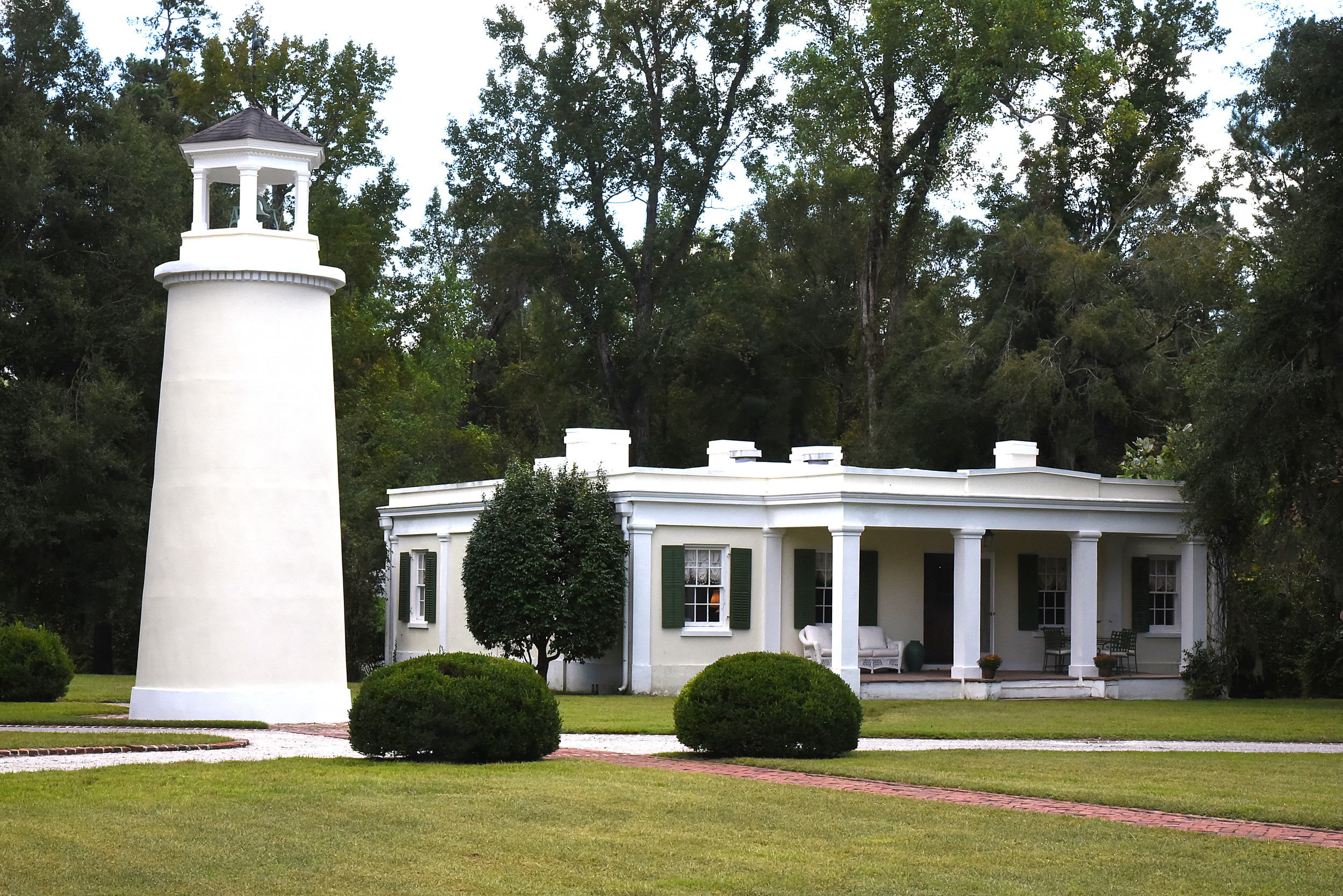 "A water tower and ""little mansion"" are visible from the back side of the main house at Millford Plantation."