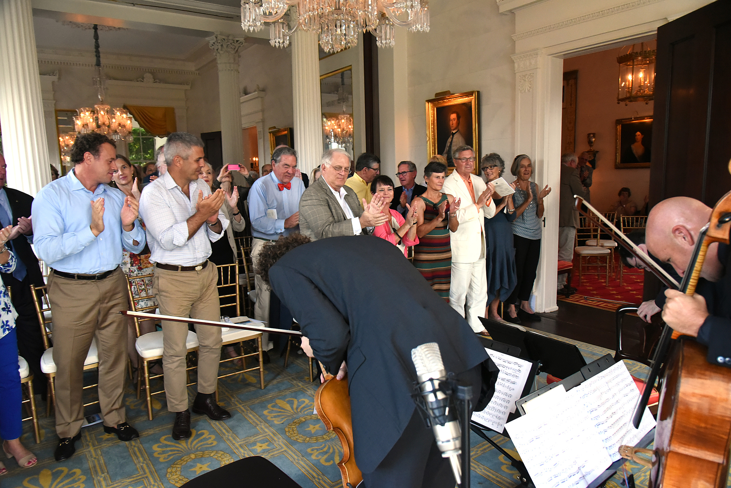 Viola performer Ben Ullery, bottom left, and cellist Robert deMaine take a bow to a standing ovation at the end of the Music at Millford concert Sunday. More than 125 guests attended the concert at Millford Plantation.