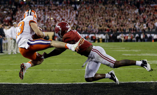 Clemson wide receiver Hunter Renfrow catches a last-second touchdown pass in front of Alabama cornerback Tony Brown in the Tigers' 35-31 victory in the College Football Playoff national championship game on Monday in Tampa, Fla.