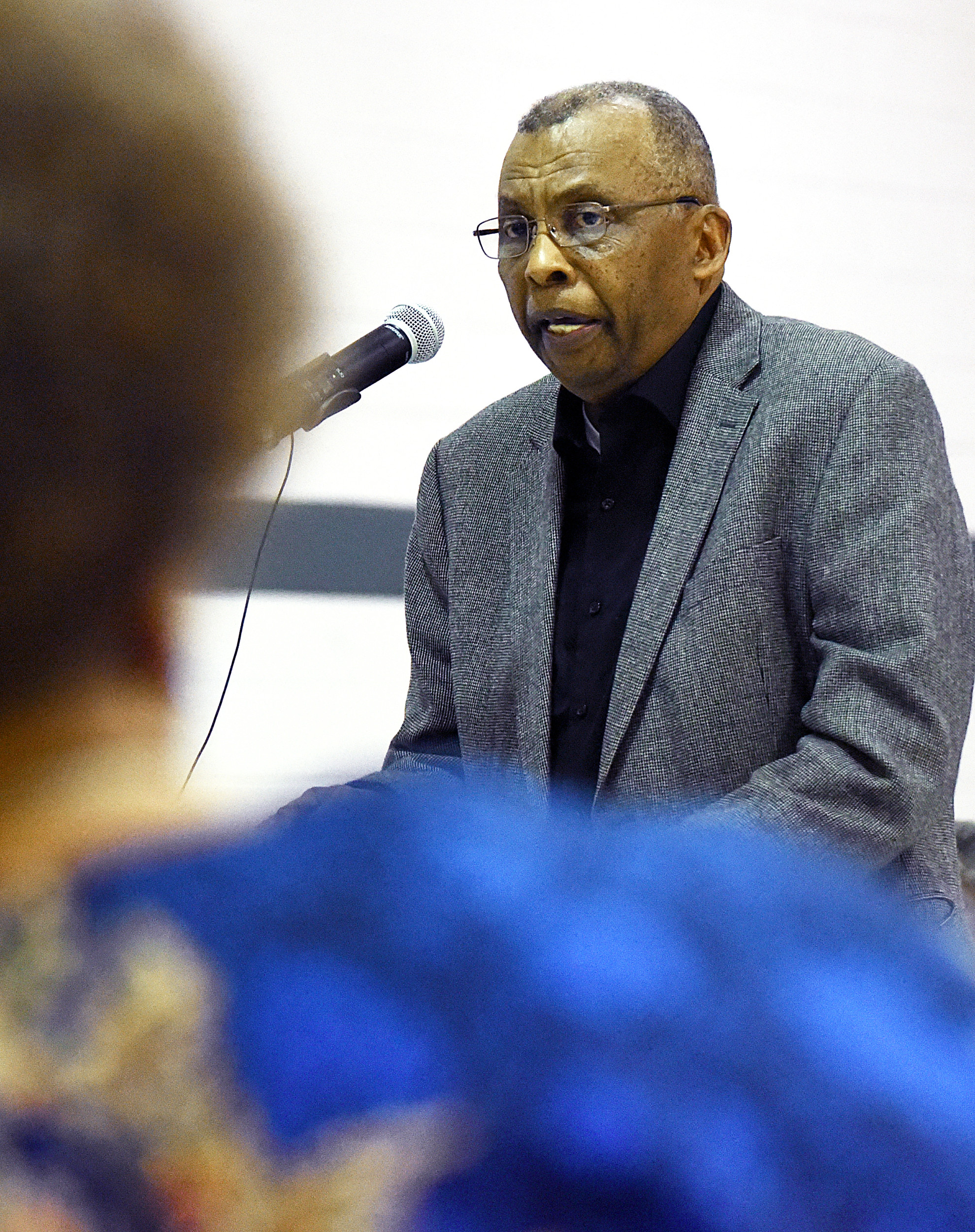 The Rev. Marion H. Newton, senior pastor of Jehovah Missionary Baptist Church, talks to the Sumter School District Board of Trustees and more than 300 citizens Monday night at Wilder Elementary School.