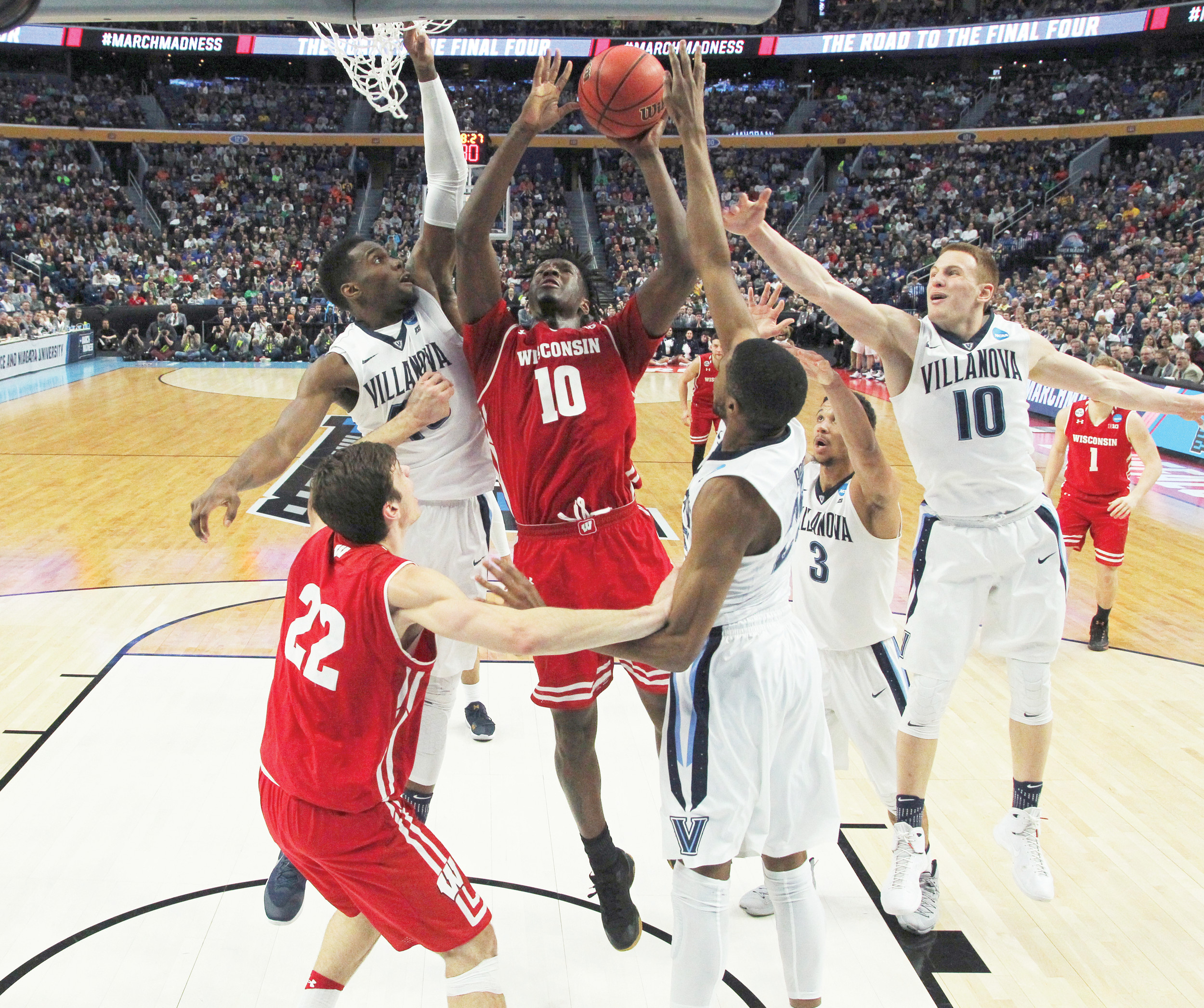 Wisconsin forward Nigel Hayes (10) goes to the basket against a slew of Villanova defenders during the Badgers' 65-62 upset victory in the second round of the men's NCAA tournament on Saturday in Buffalo, New York.