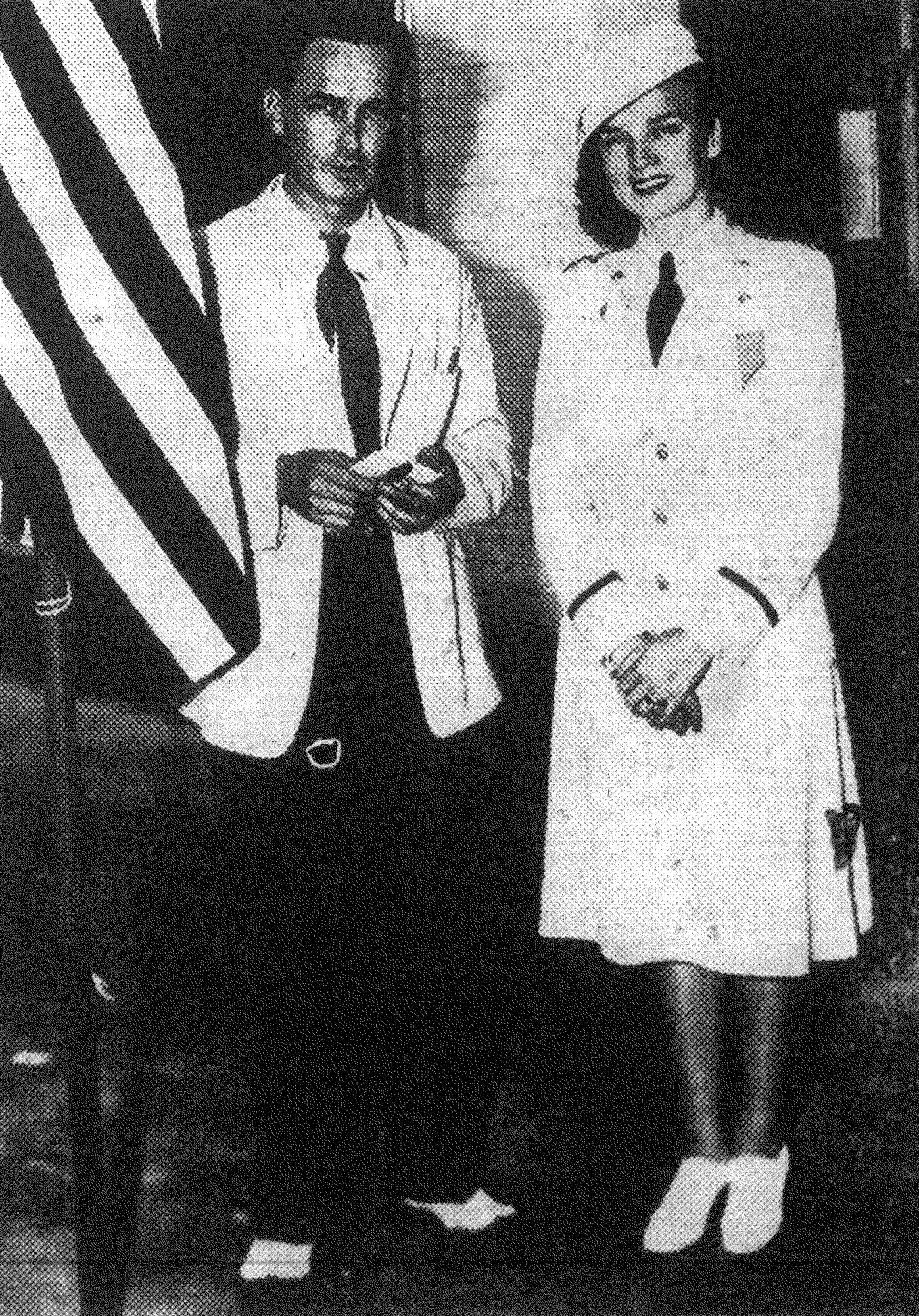 Lt. Juanita Redmond, who escaped capture by the Japanese on Bataan peninsula and at Corregidor, is seen with her brother, Robert.