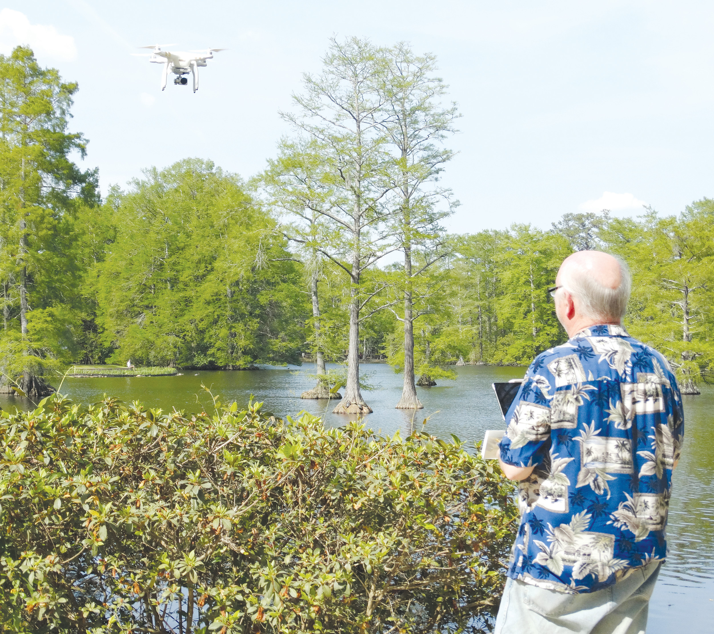 Hap Griffin, a nationally known astrophotographer, flies a drone on Saturday at Swan Lake-Iris Gardens. Griffin is making a video of Sumter landmarks, including the gardens, and was capturing video of specific parts of the gardens.