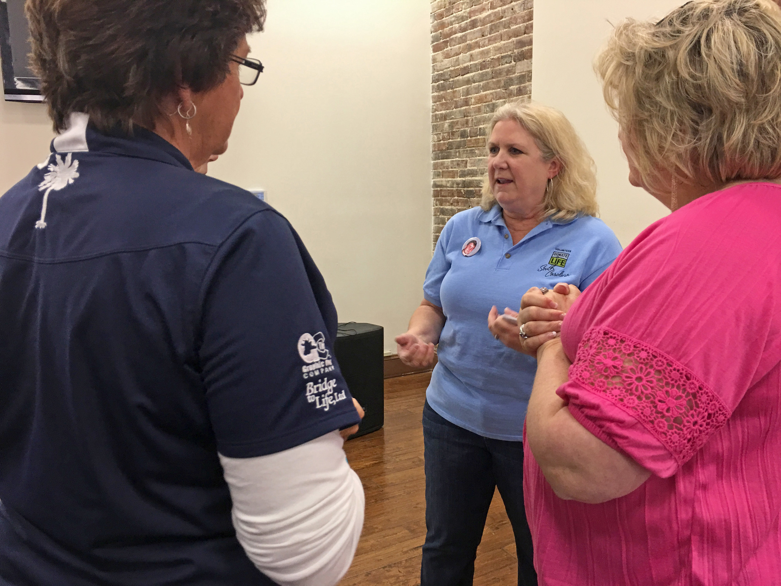 Lynn Finley, center, talks about organ donation with local health care professionals Wednesday at the City Centre in downtown Sumter.
