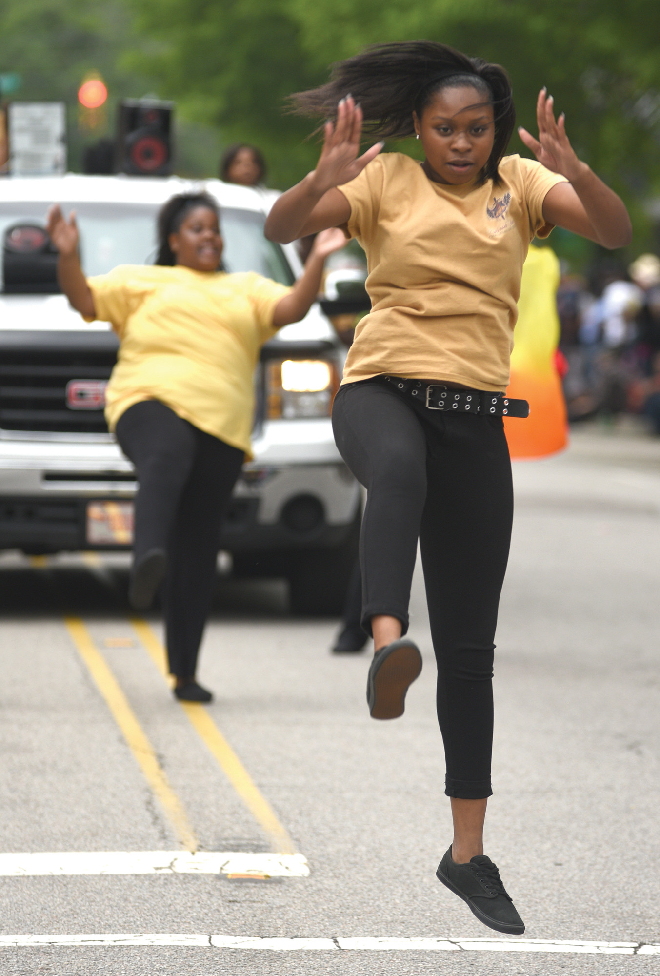 Members of Fresh Fire Christian Life Center dance and jump to music during last year's parade.