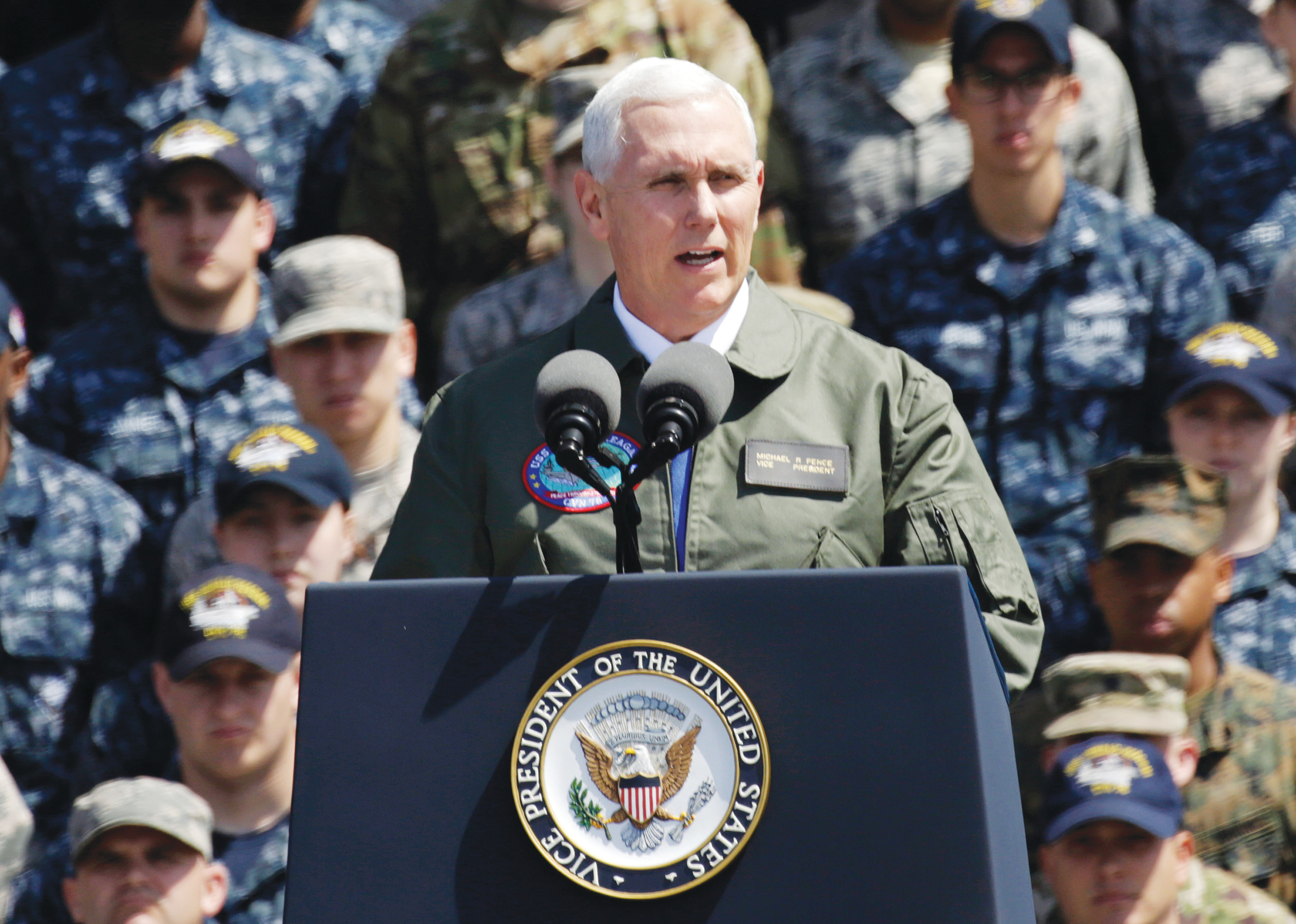 U.S. Vice President Mike Pence speaks to U.S. servicemen and Japanese Self-Defense Forces personnel on the flight deck of U.S. Navy nuclear-powered aircraft carrier USS Ronald Reagan at the U.S. Navy's Yokosuka base in Yokosuka, south of Tokyo, on Wednesday.