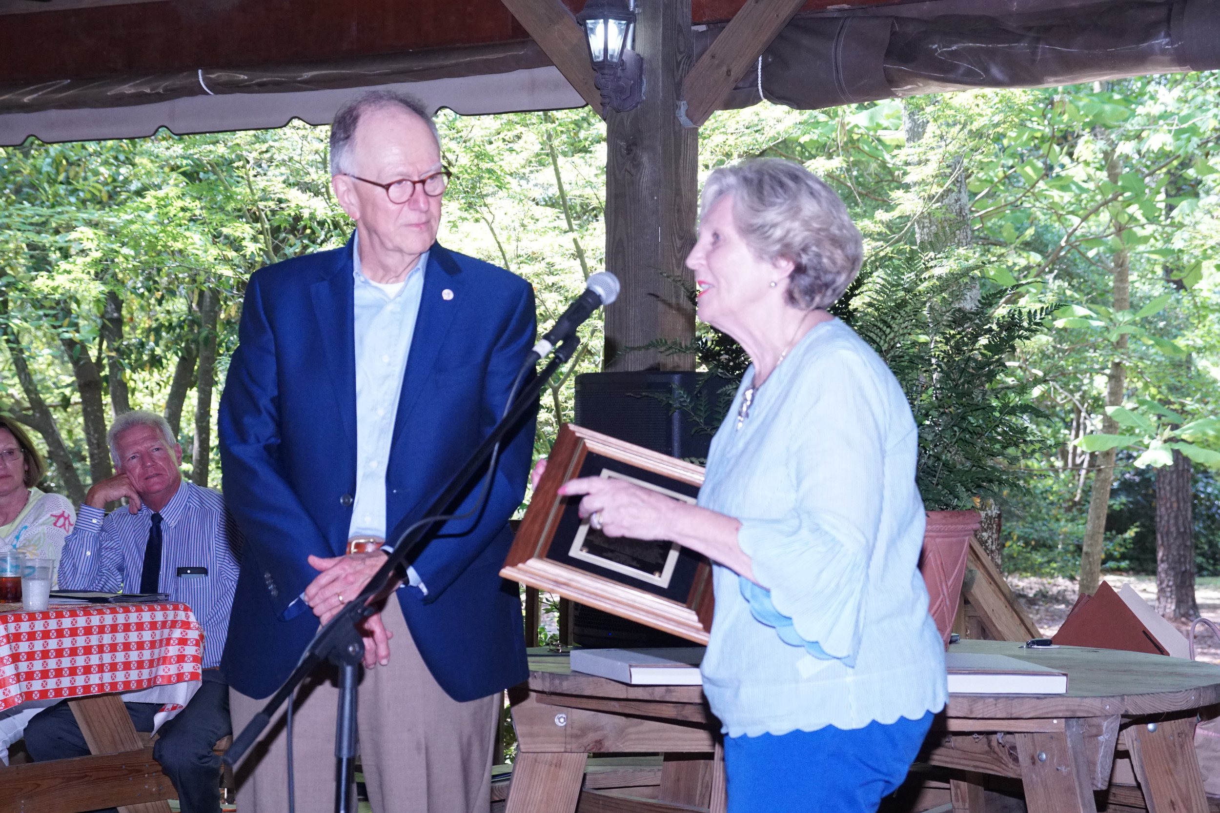 Sister Wimberly accepts her Sumter Community Service Award from Mayor Joe McElveen at the Sumter Volunteer Awards luncheon Thursday at Swan Lake's Heath Pavilion.