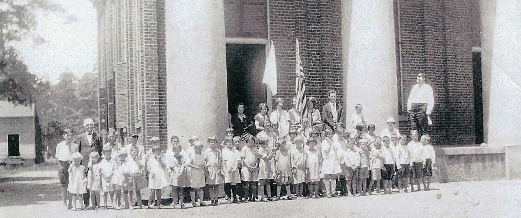 PHOTO PROVIDED  Children are seen visiting Brick Church circa 1940s.