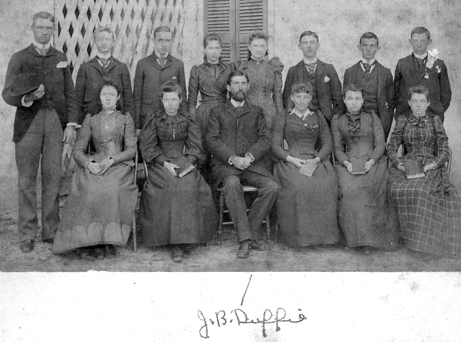 John Duffie, seated center, was the first elected superintendent of city schools.