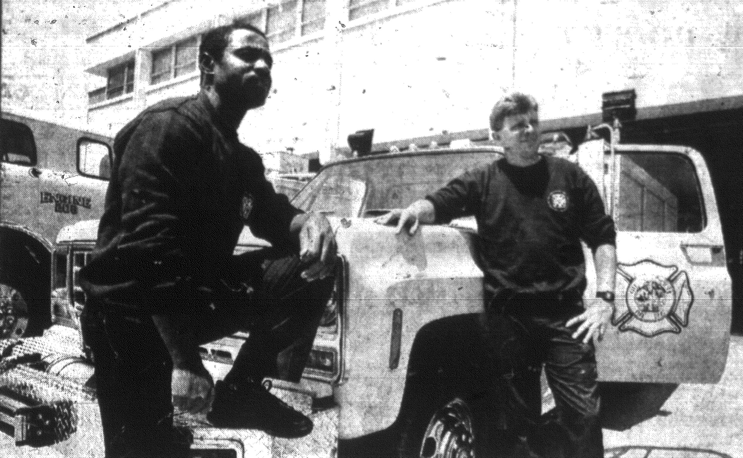1992 - Sumter firefighters Johnnie Rose, left, and Dennis Powell stand with the city's new emergency truck. With the help of a local manufacturer, fire crews made the truck for about $10,000, $50,000 less than the price of a new truck.