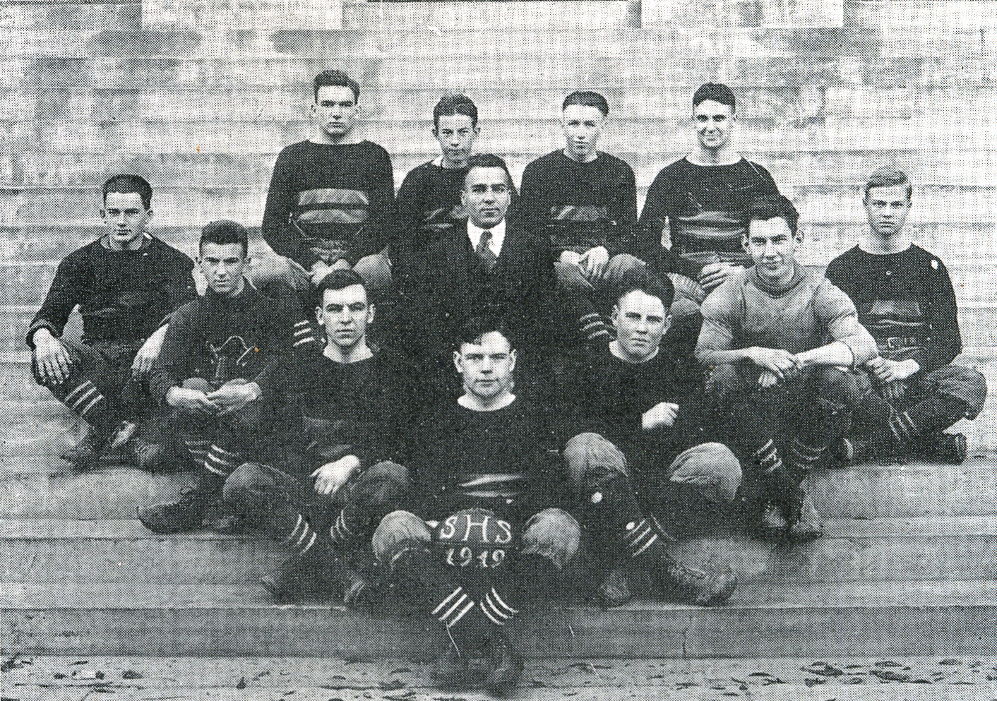 "The ""regular"" football team is pictured in the 1920 Sumter High School yearbook. Top row: Harold DeLorme (rt. half-back), George Wray (l. half-back), Clinton Wheeler (full back) and Julius Pitts (quarterback). Middle row: Coach Dargan. Bottom row: Coit Kirven (rt. end); Hubert Osteen (rt. tackle); John Haynsworth (rt. guard); DuPre Rhame (captain, center); James Hatfield (L. guard); James Burms (l. tackle); Jack Wright (l. end)."