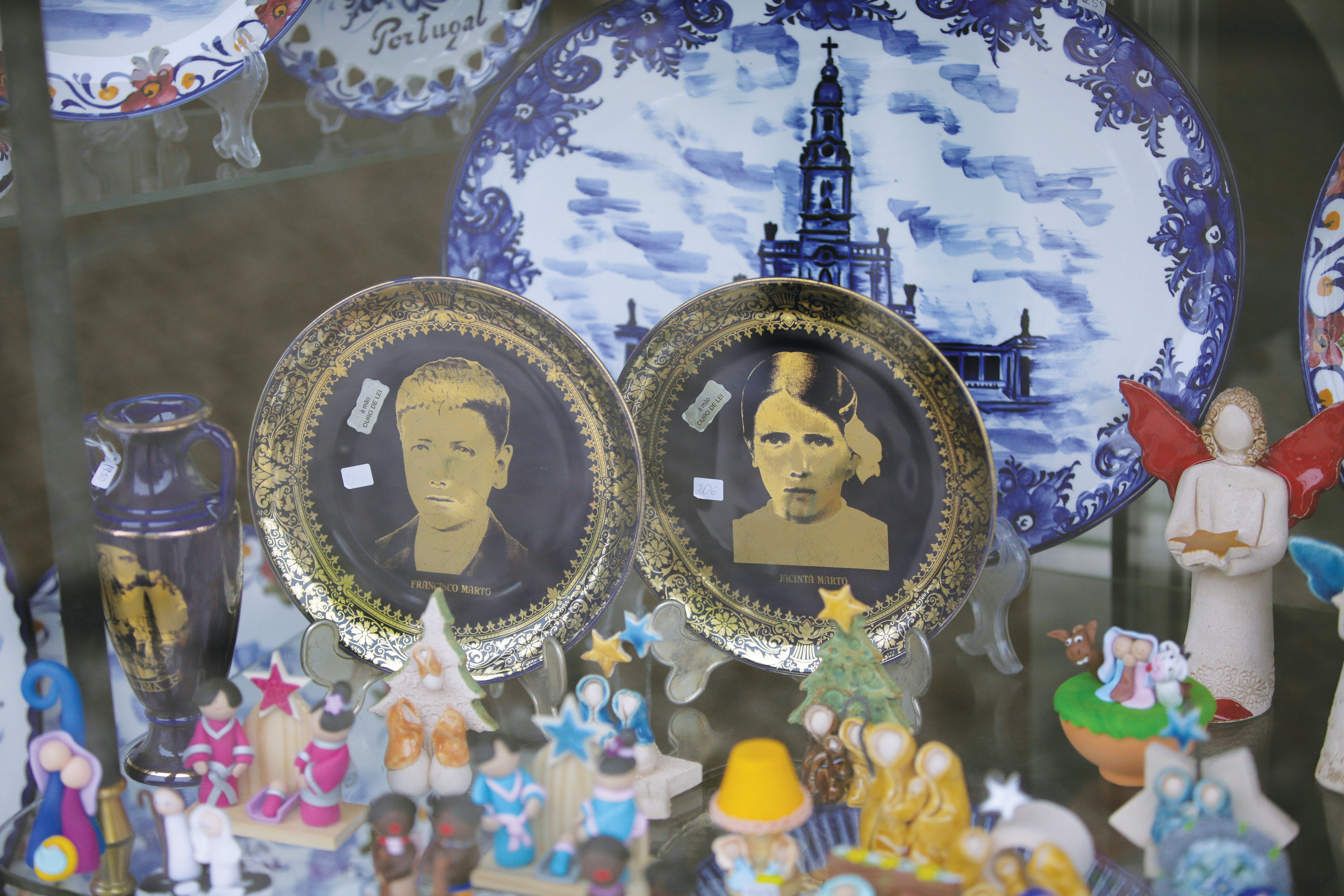 China plates with images of Francisco and Jacinta Marto are displayed for sale on May 4 in a shop window in Fatima, Portugal. Pope Francis visited the Fatima shrine on May 12 and 13 to canonize Francisco and Jacinta Marto, two Portuguese shepherd children who say they saw visions of the Virgin Mary 100 years ago.