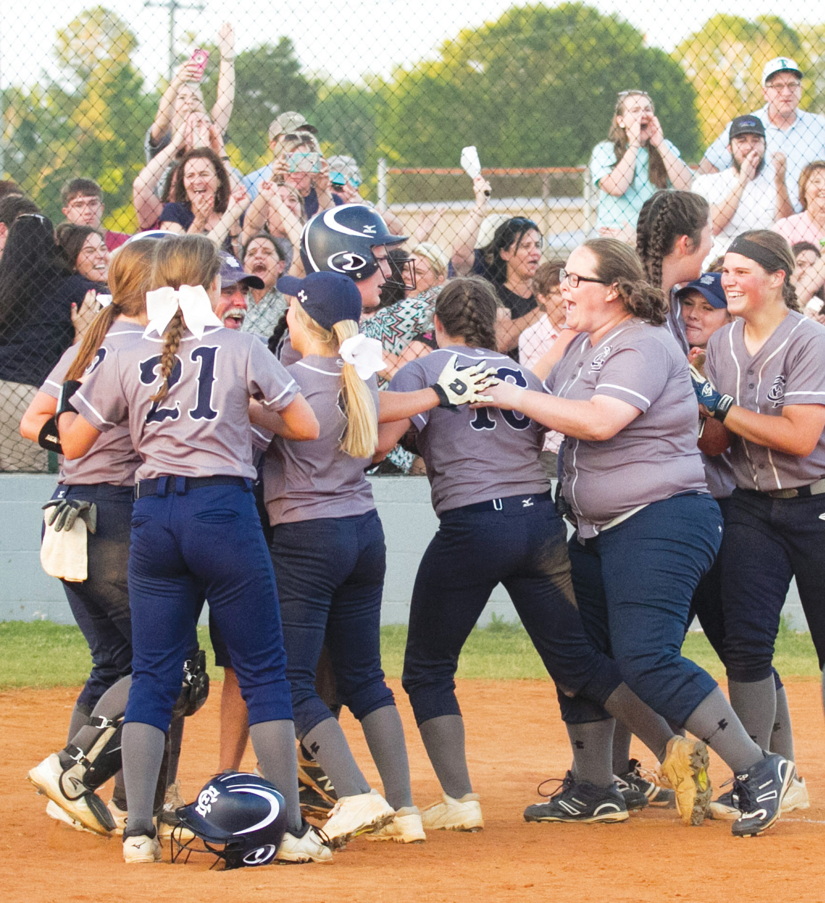 The East Clarendon softball team celebrates after rallying to defeat Dixie 4-3 on Wednesday to claim the 1A state championship at the EC field. The Lady Wolverines swept the best-of-3 championship series.