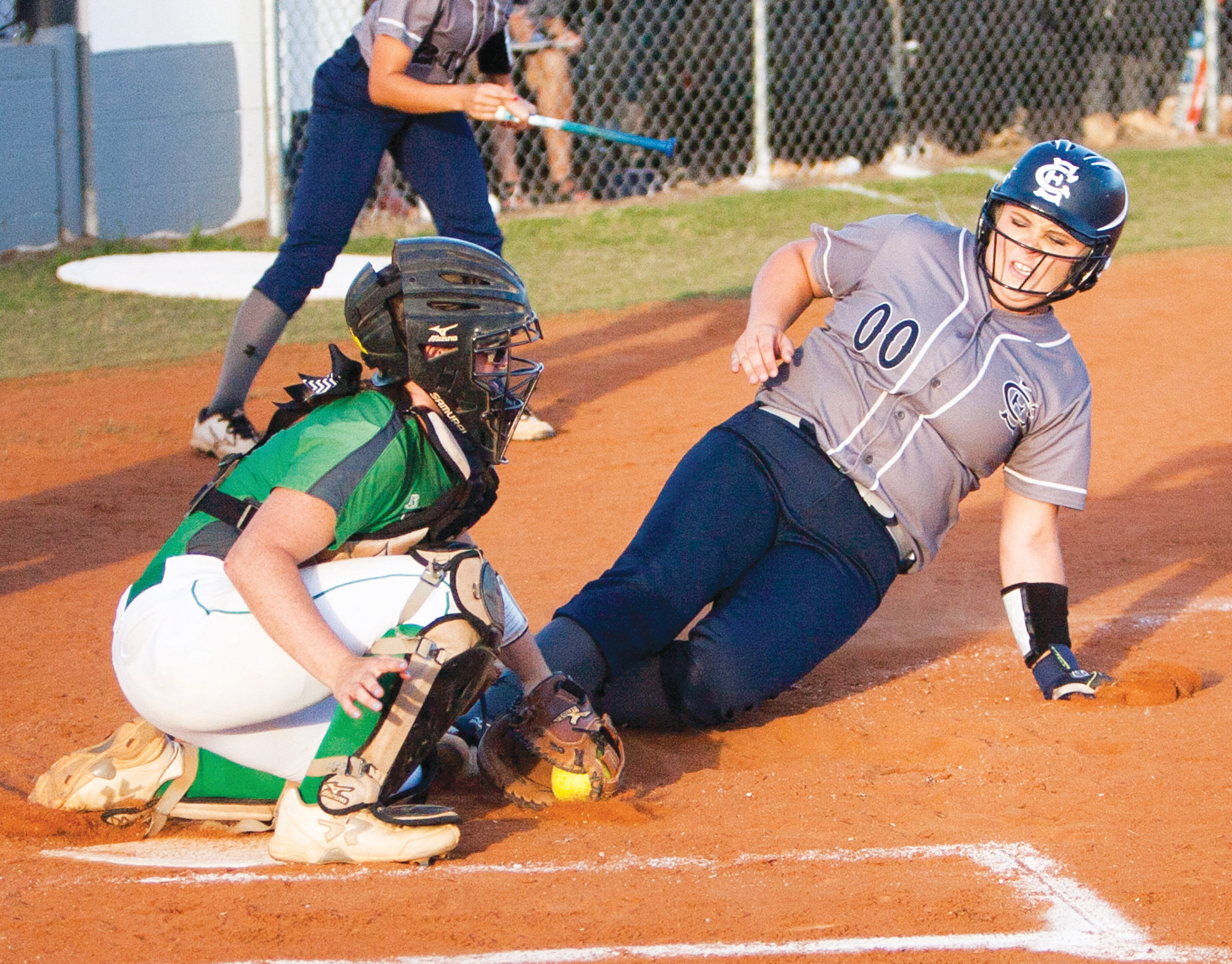 East Clarendon's Mikayla Anderson (00) slides safely into home as Dixie catcher Bailee New takes the throw in the Lady Wolverines' 4-3 victory on Wednesday at the EC field in winning it's the 1A state title.