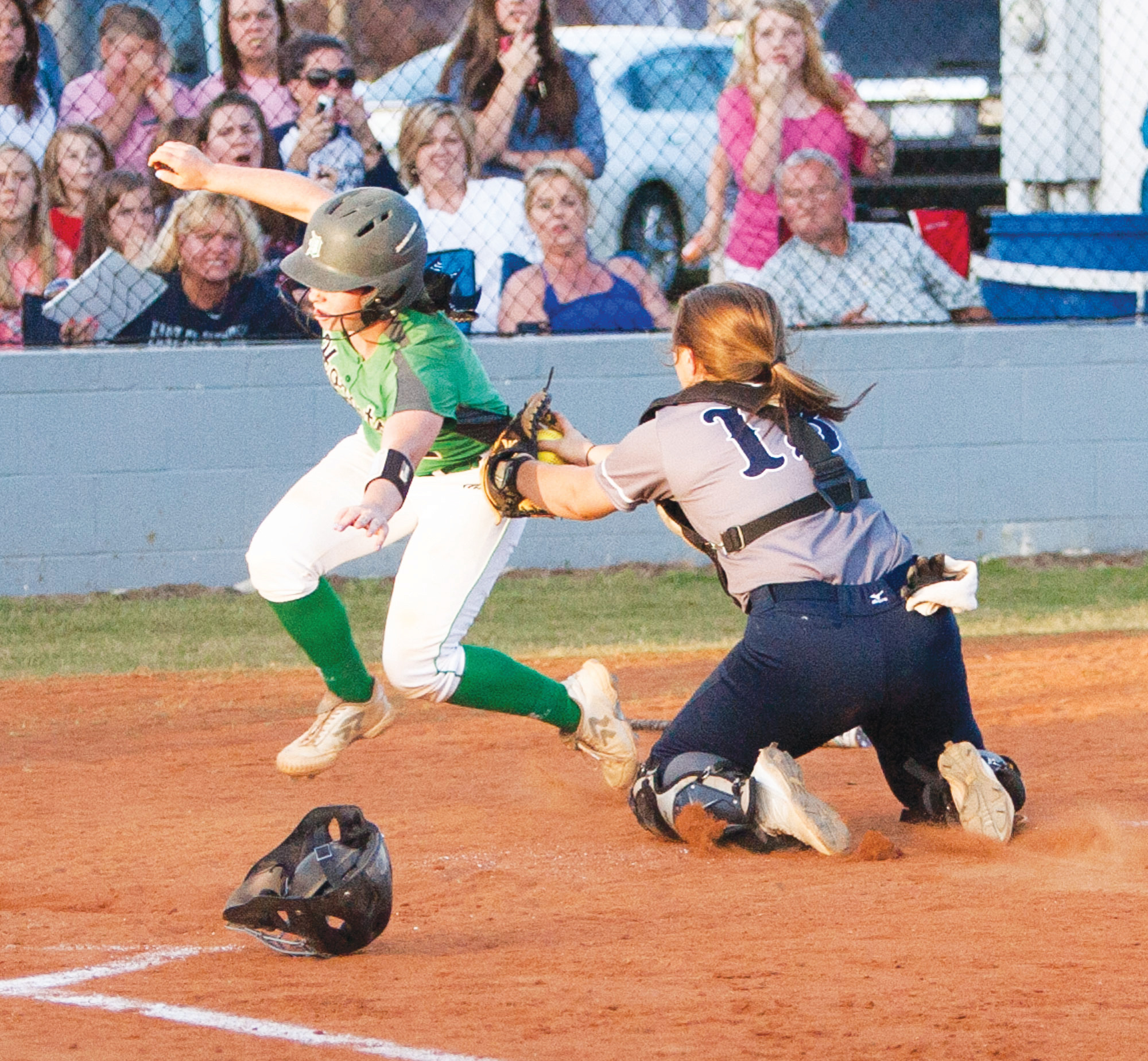 Dixie's Lauren Davenport (7) runs around the attempted tag of East Clarendon catcher Abby Reardon in the Lady Wolverines' 4-3 victory on Wednesday in Turbeville. The victory gave the Lady Wolverines the 1A state title.
