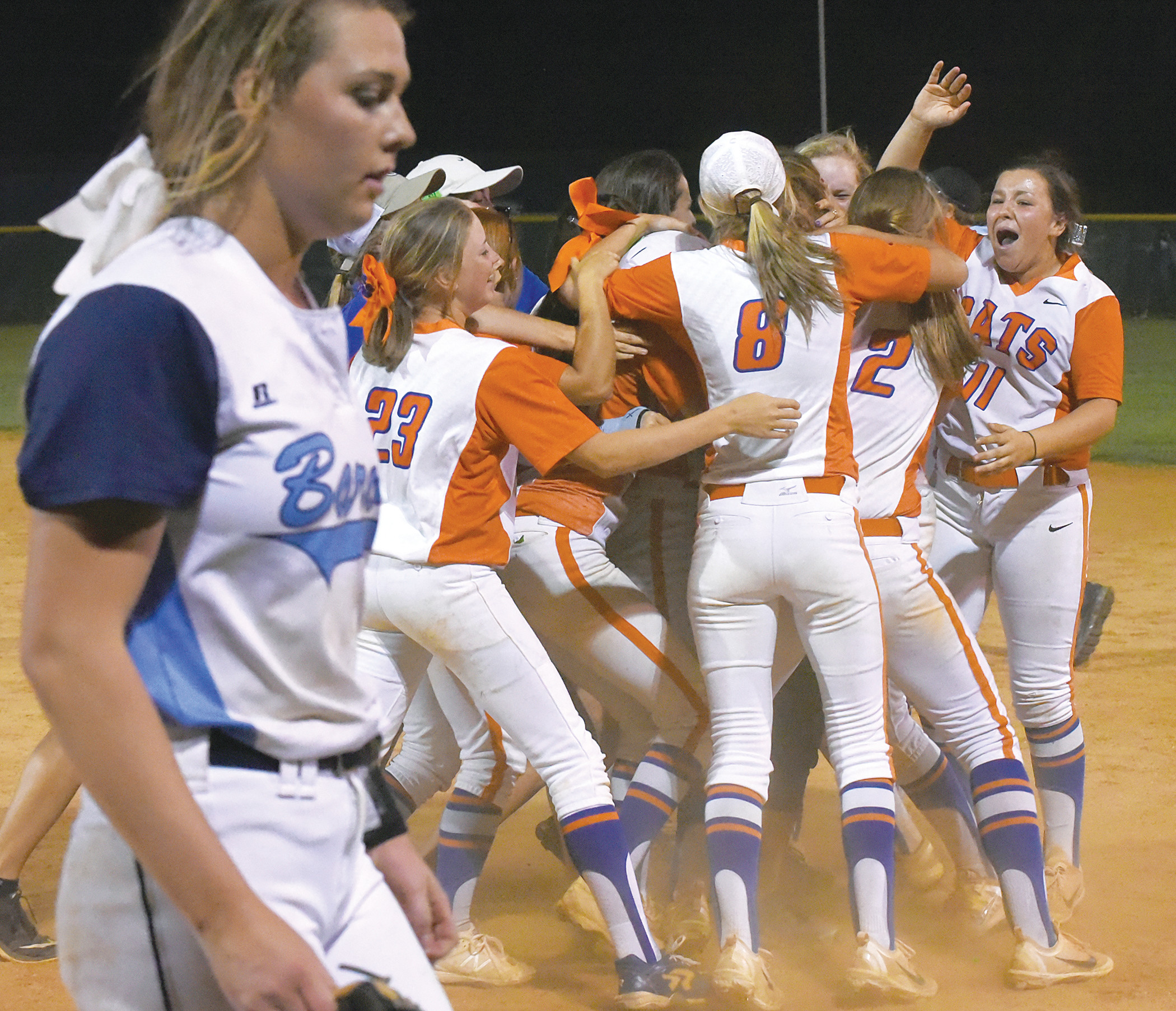 The Laurence Manning Academy softball team celebrates after defeating Wilson Hall 3-2 in eight innings to defend its SCISA 3A state championship on Wednesday at the Lakewood High School field. The Lady Swampcats scored a run in the bottom of the seventh to tie the game and won it in the eighth.