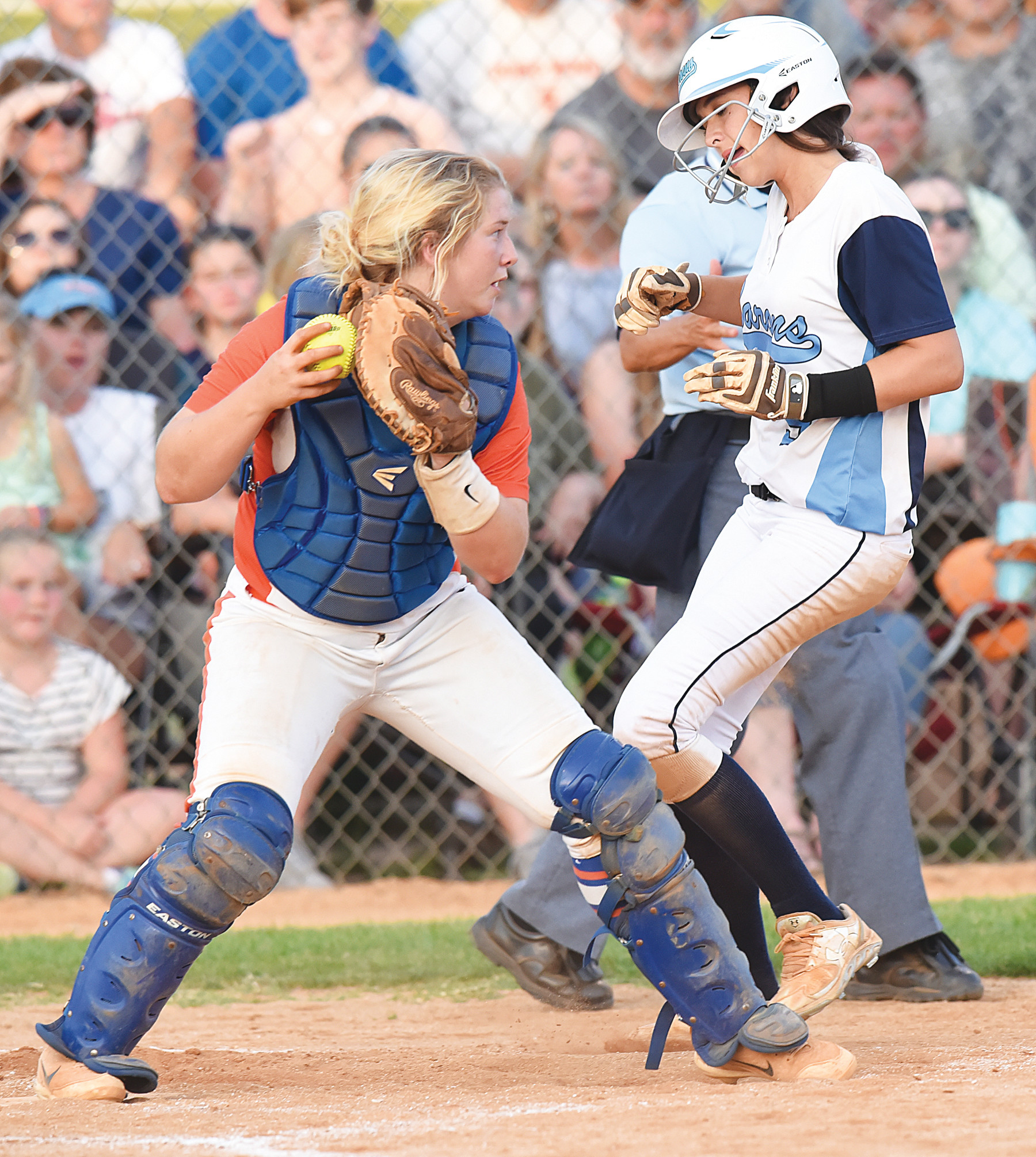 Laurence Manning Academy catcher Baylee Elms, left, forces out Wilson Hall's Kathryn  Sistare at home during the Lady Swampcats' come-from-behind 3-2 victory in eight innings in the deciding game of the SCISA 3A state championship series on Wednesday at the Lakewood High School field.