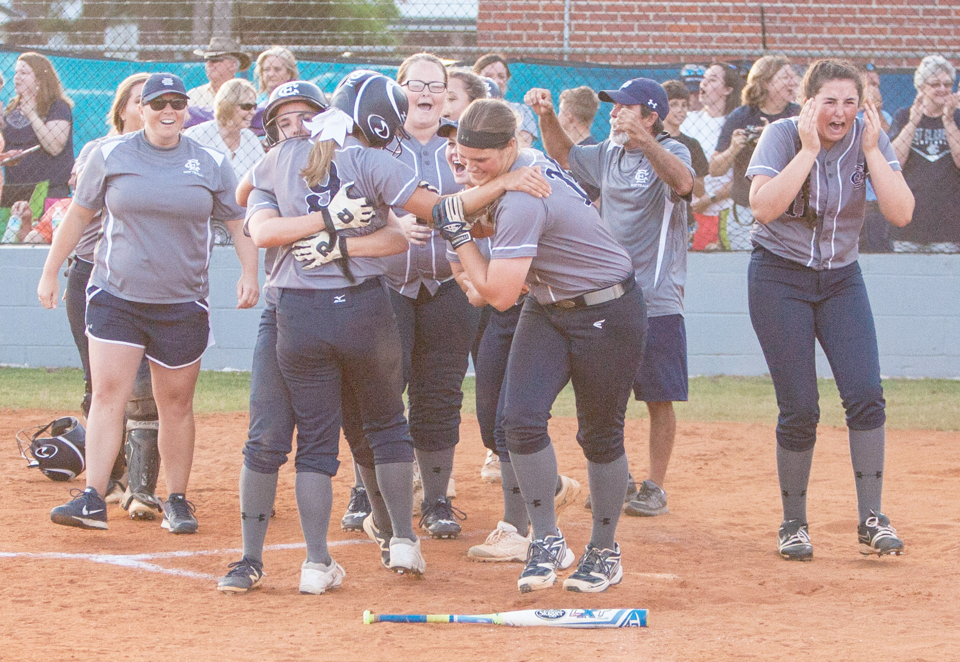 Members of the East Clarendon High School softball team celebrate winning the 1A state championship on Wednesday at the ECHS field in Turbeville after the Lady Wolverines rallied for two runs in the bottom of the seventh inning in a 4-3 victory over Dixie.