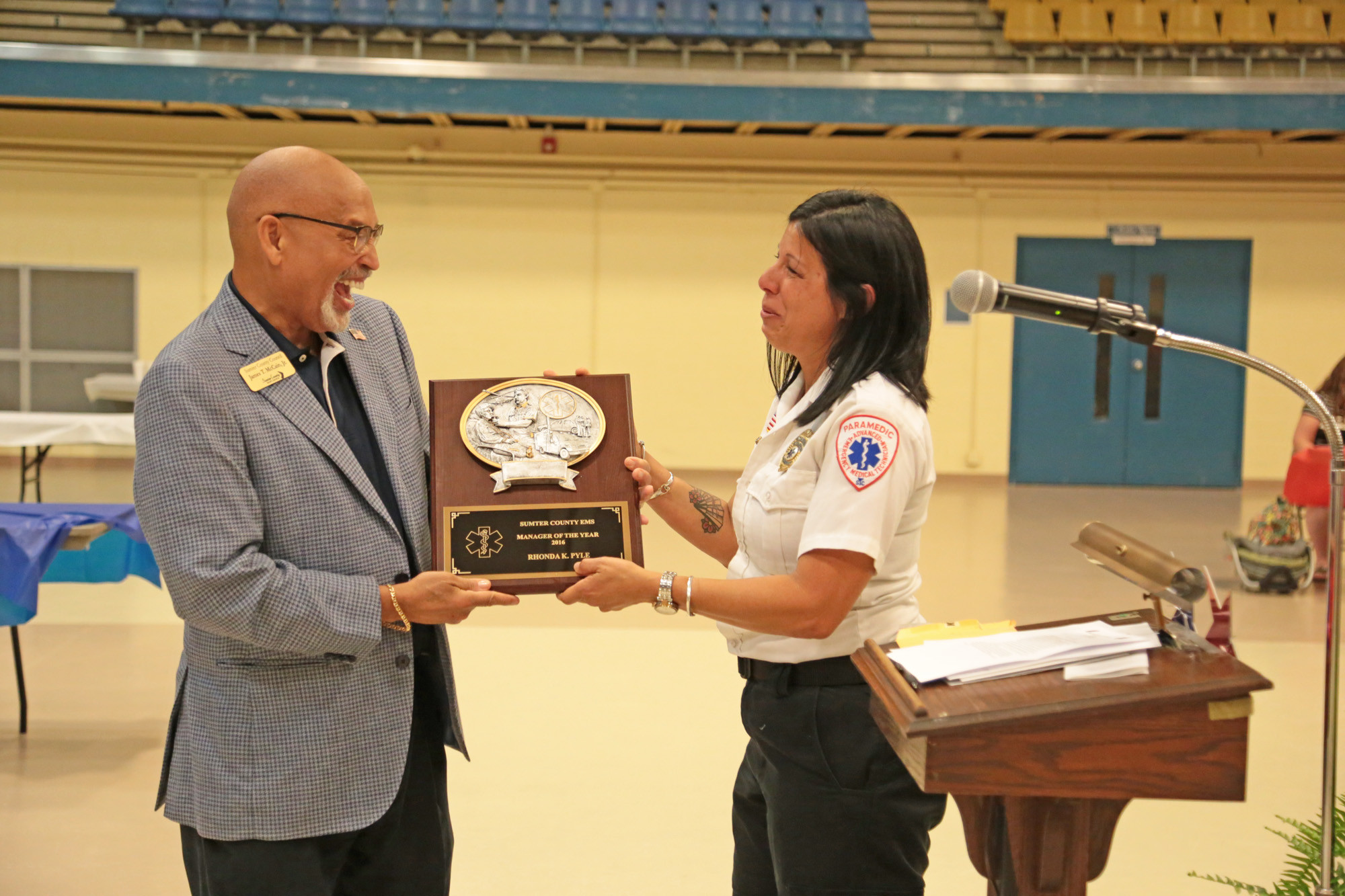 Sumter County Council Chairman James T. McCain Jr., left, hands a plaque to Ronda Pyle, named EMS Manager of the Year during the banquet.