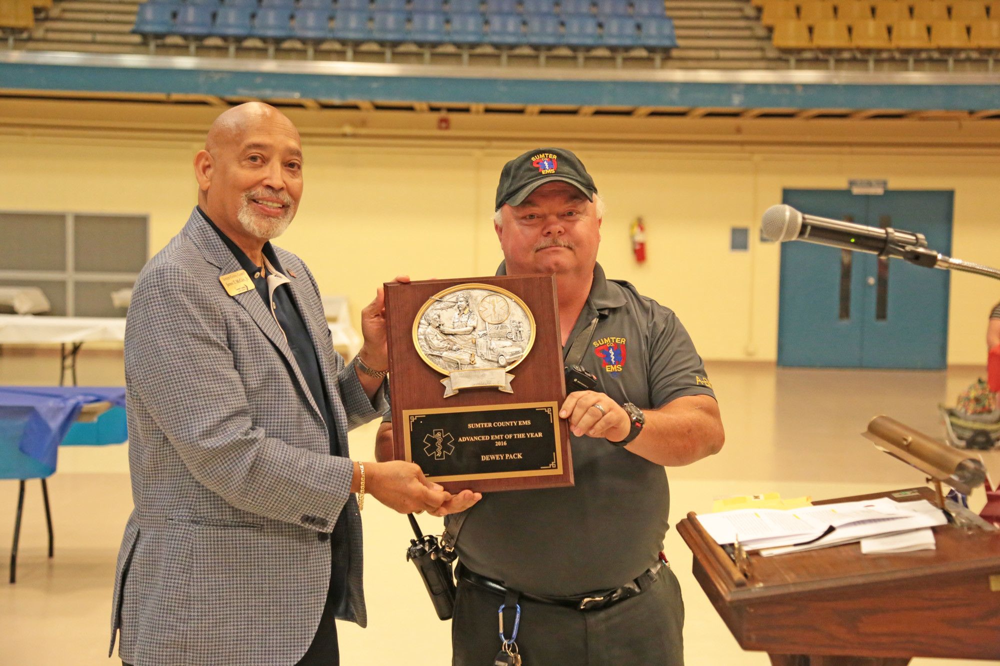Sumter County Council Chairman James T. McCain Jr., left, hands a plaque to Dewey Pack, named Advanced EMT of the Year at 2017 Sumter County Awards Banquet at Sumter County Civic Center on May 11.