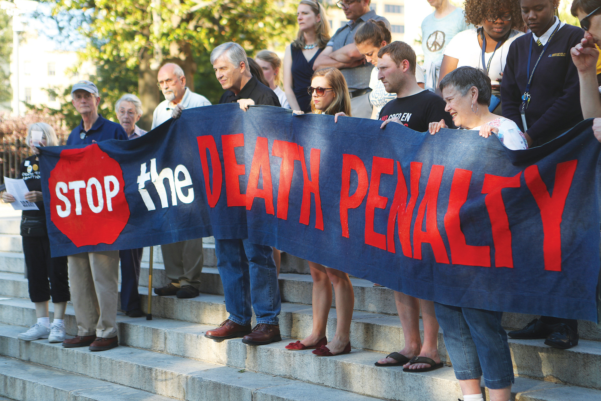 Death penalty opponents protest the planned execution of J.W. Ledford for the 1992 murder of his elderly neighbor at the State Capitol on Tuesday in Atlanta.