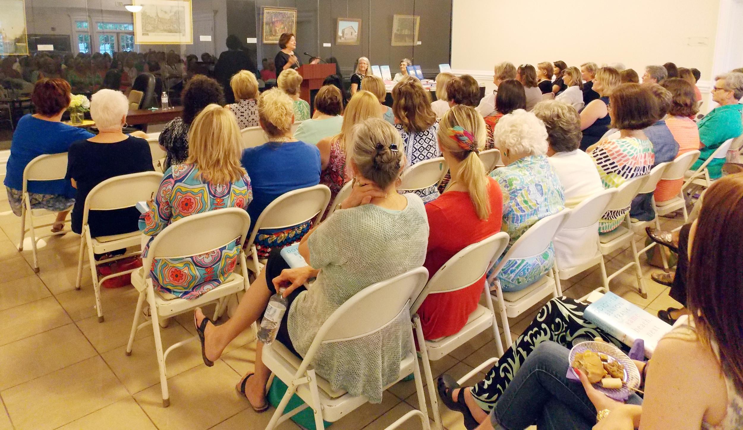 "Dorothea Benton Frank speaks to a sold-out crowd at the Sumter County Museum on Tuesday night. The event, sponsored by Books-A-Million, was a signing of her just-released new book, ""Same Beach, Next Year."""