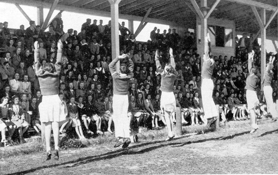 The 1941 Edmunds (Sumter) High School cheerleaders pep up the crowd before a football game.