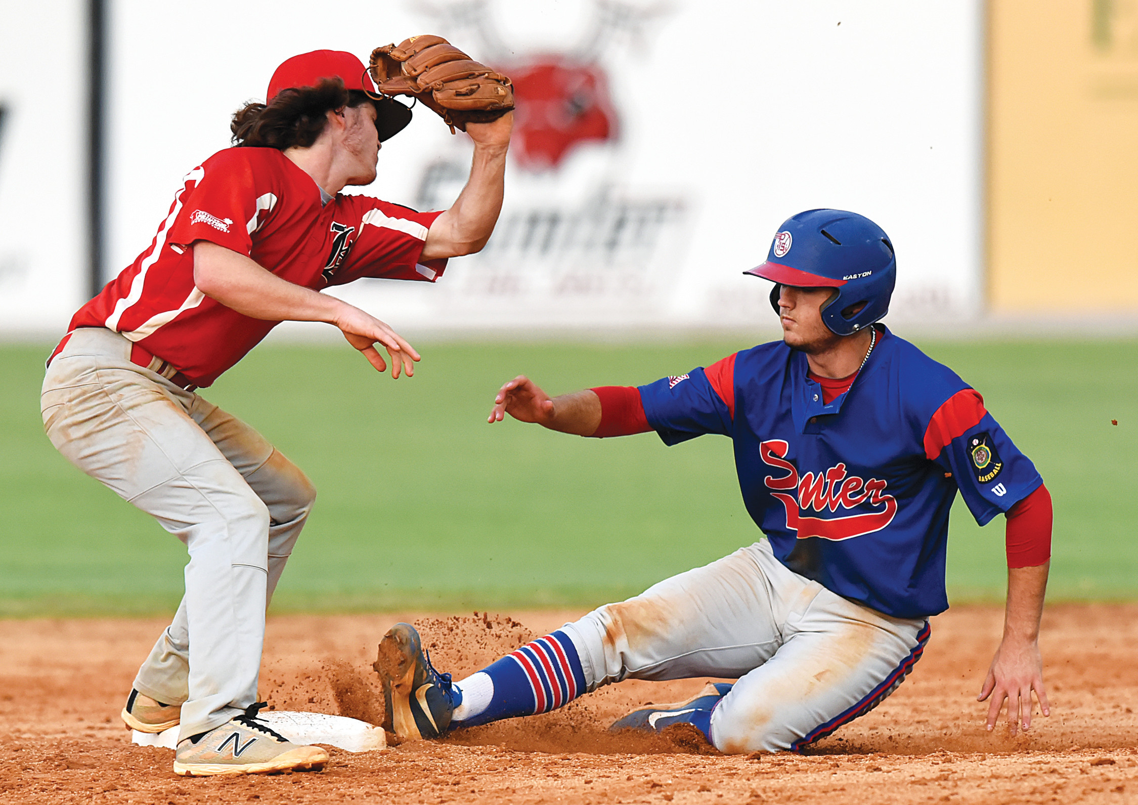 Sumter's Dawson Price slides safely into second base for a stolen base as Hartsville second baseman Matt Lynch tries to get a tag  down in the P-15's 11-6 victory on Tuesday at Riley Park.