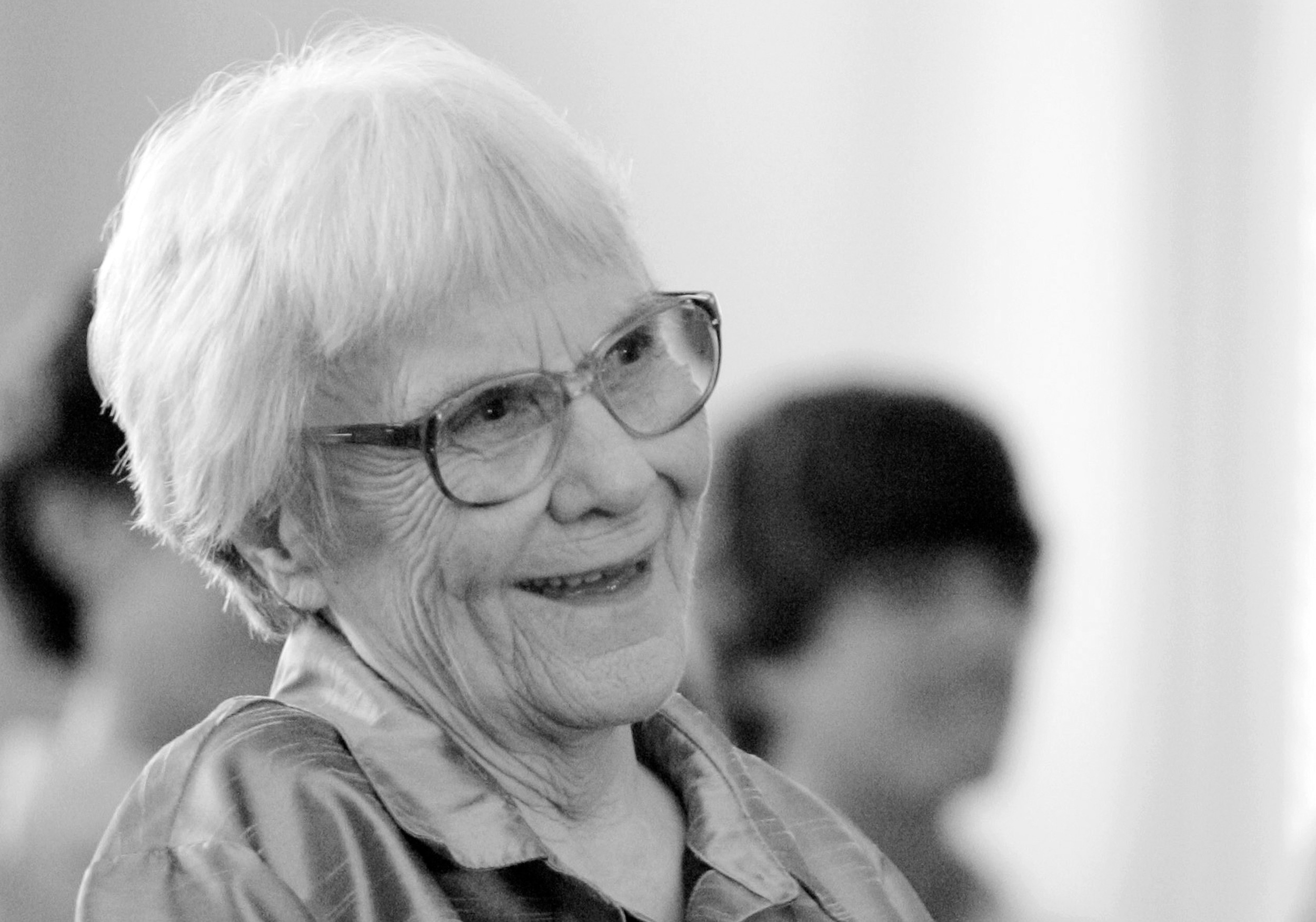 """To Kill A Mockingbird"" author Harper Lee smiles during a ceremony honoring the four new members of the Alabama Academy of Honor at the state Capitol in Montgomery, Alabama.   AP FILE PHOTO"