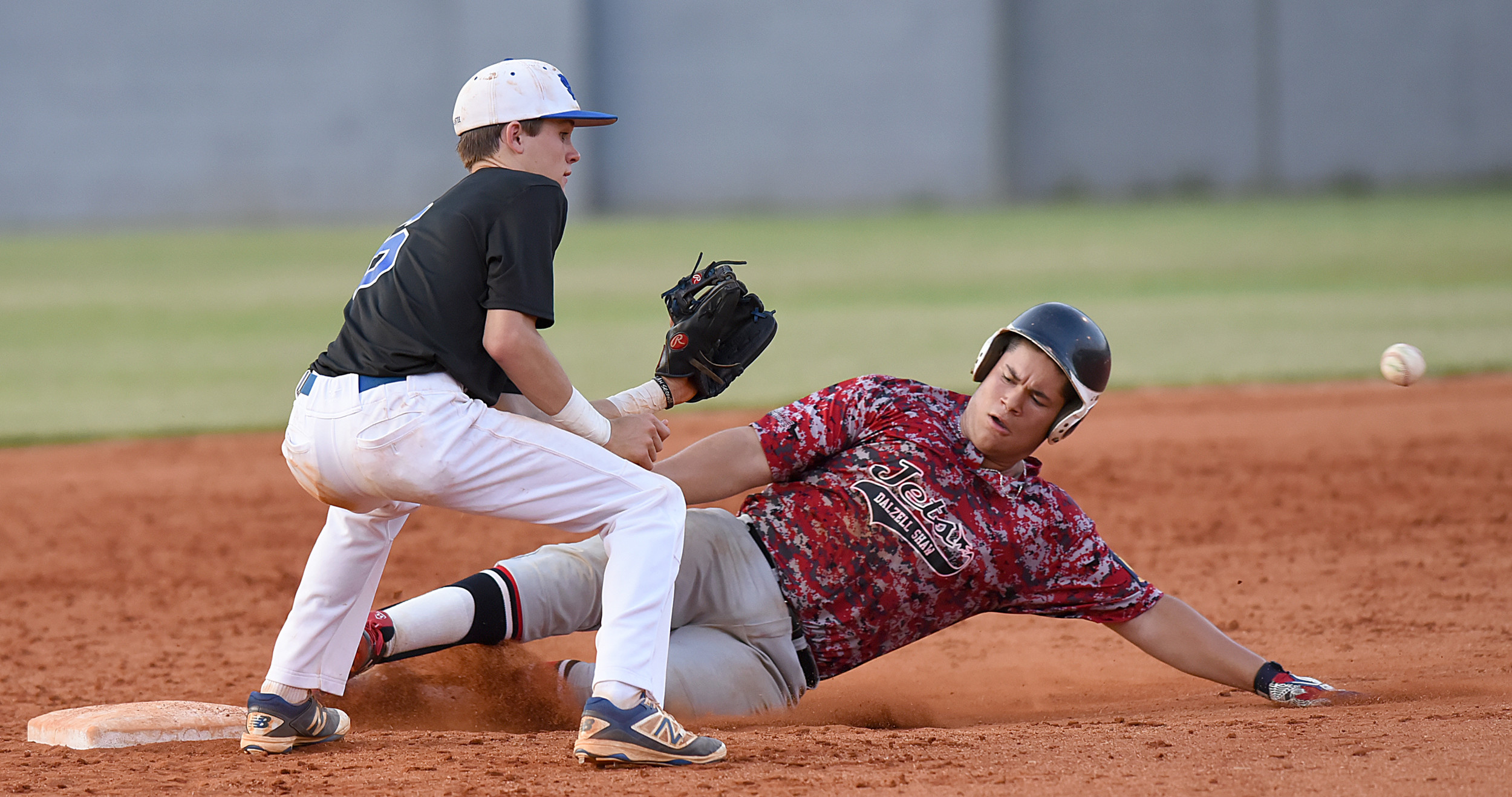 Dalzell-Shaw's Lenny Gonzalez slides safely into second base as Manning-Santee shortstop Taylor Lee waits on the throw during Post 68's 5-4 win on Friday in Manning.