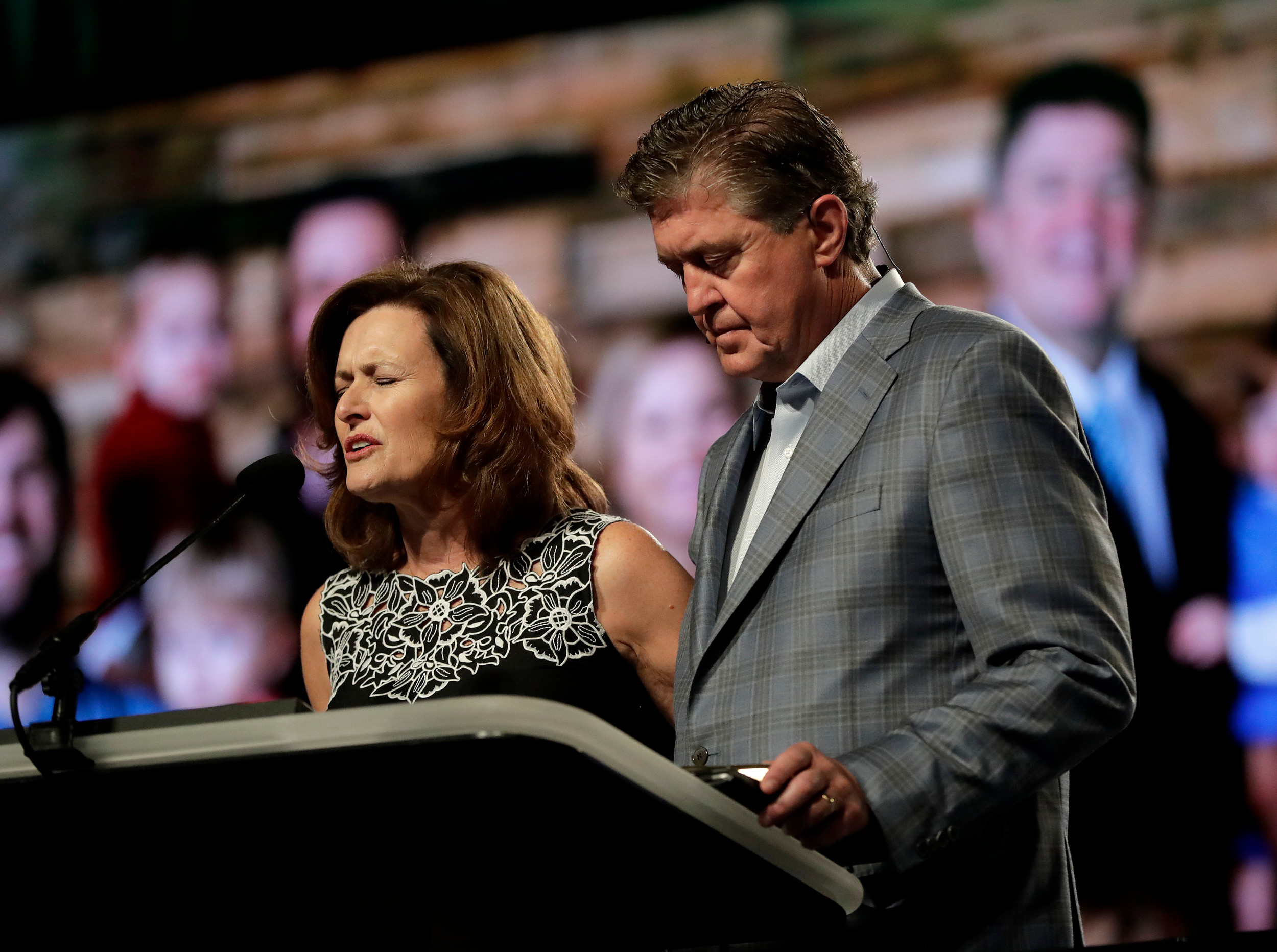 THE ASSOCIATED PRESSDr. Steve Gaines and his wife, Donna, pray prior to the president's address during the Southern Baptist Convention annual meeting 	on Tuesday.