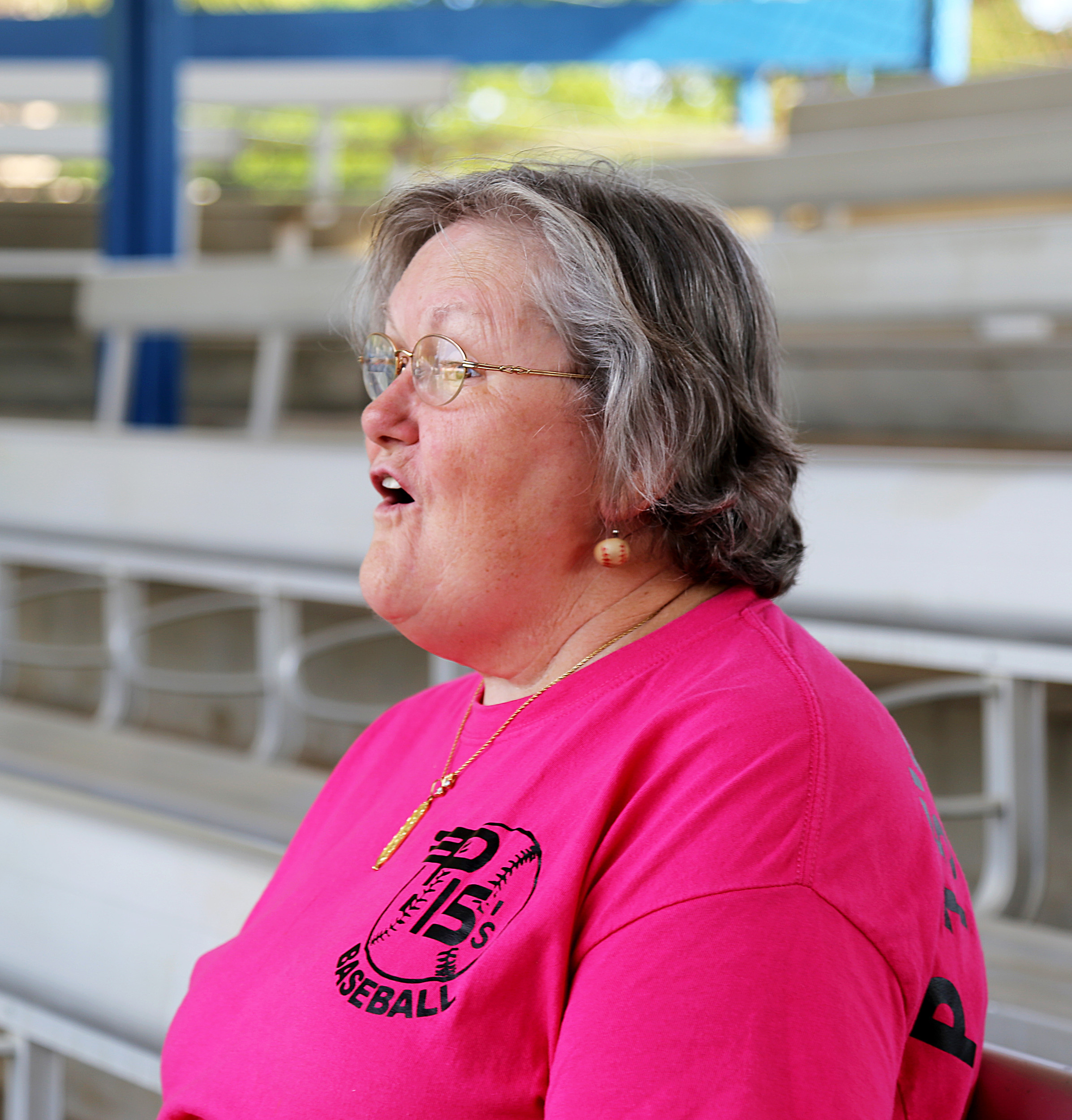 """P-15's """"Foul Ball Lady,"""" Shirley Osborne, announces yet another foul ball."""