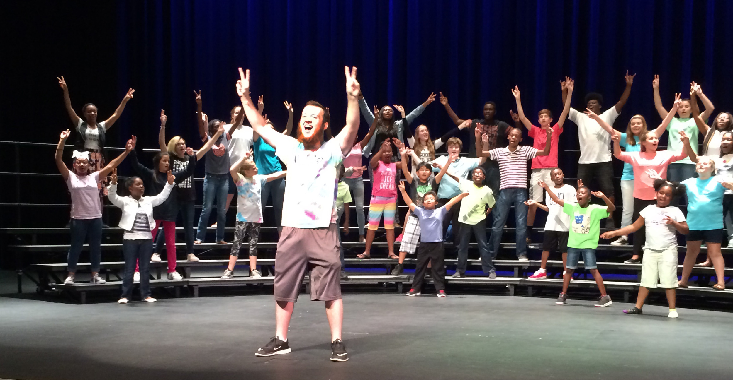 "Justin Floyd, who has participated in several REACH Summer Arts programs, rehearses ""Hey, Jude"" with the REACH chorus. Having just completed his sophomore year at Sumter High School, he'll be attending the Governor's School for the Arts in the fall."
