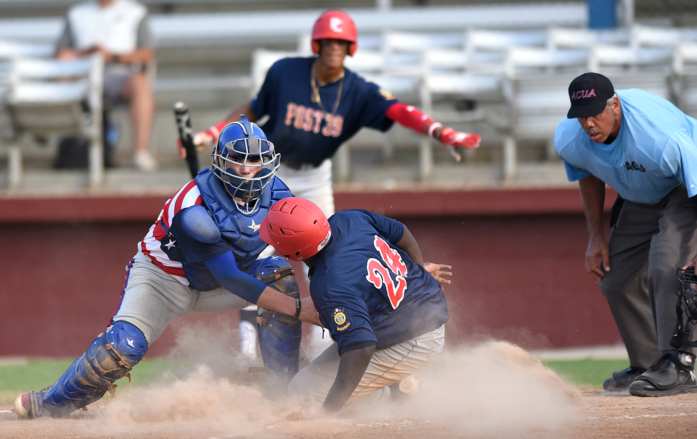 Ty'Shawn Barret (24) of Pitt County, N.C., is tagged out at home plate by Sumter catcher Cory Blackley in the P-15's 9-3 loss on Sunday in the North/South Tournament of Champions.