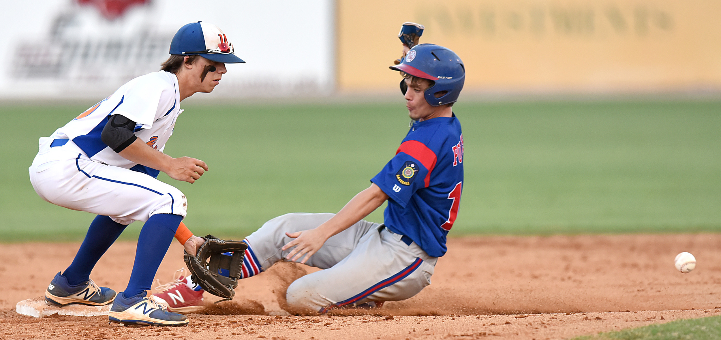 Sumter's Ryan Touchberry slides into second base for a stolen base as Wallace, N.C., shortstop Sawyer Smith waits on the throw in the P-15's 7-4 victory in the Palmetto Invitational on Friday at Riley Park..