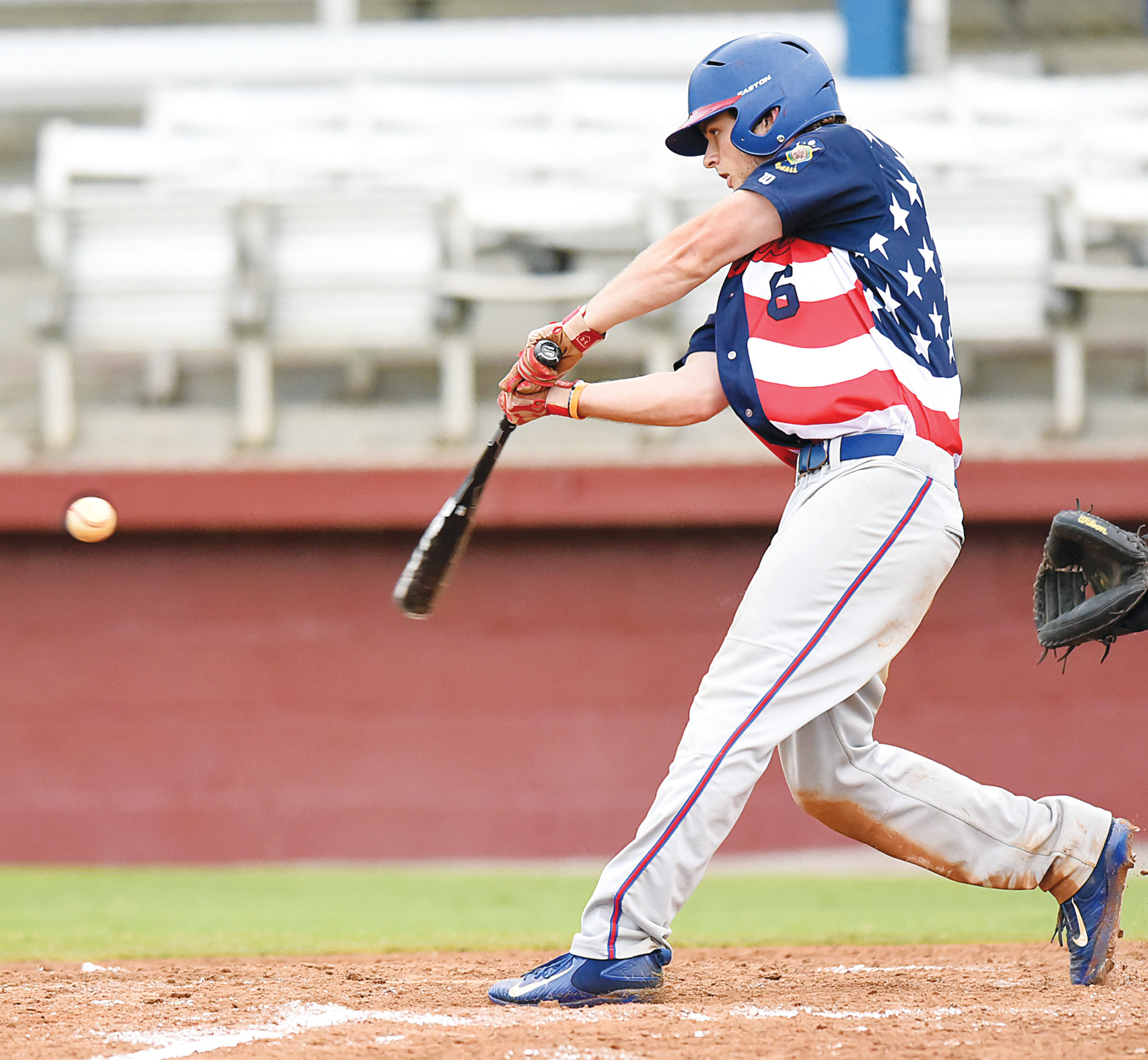 Right fielder Caleb Larrimore hits a live drive up the middle during the P-15's 15-1 victory over Beverly-Lowell, Ohio, in the Palmetto Invitational Tournament on Saturday at Riley Park.