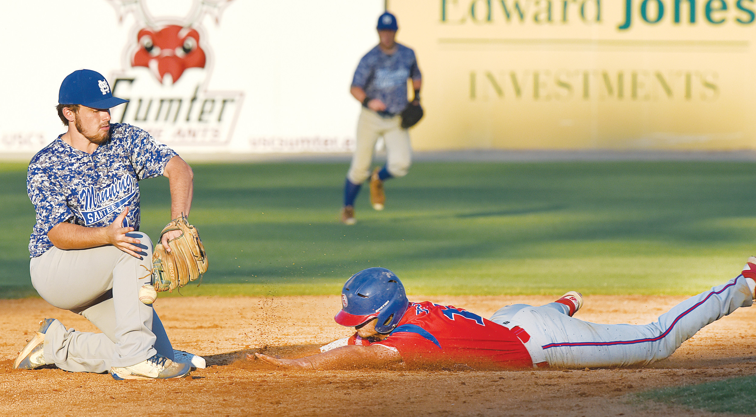 Manning-Santee second baseman Braydon Osteen, left, tries to hang onto the ball as Sumter's Dawson Price safely steals second base during the P-15's 8-1 victory on Monday at Riley Park.