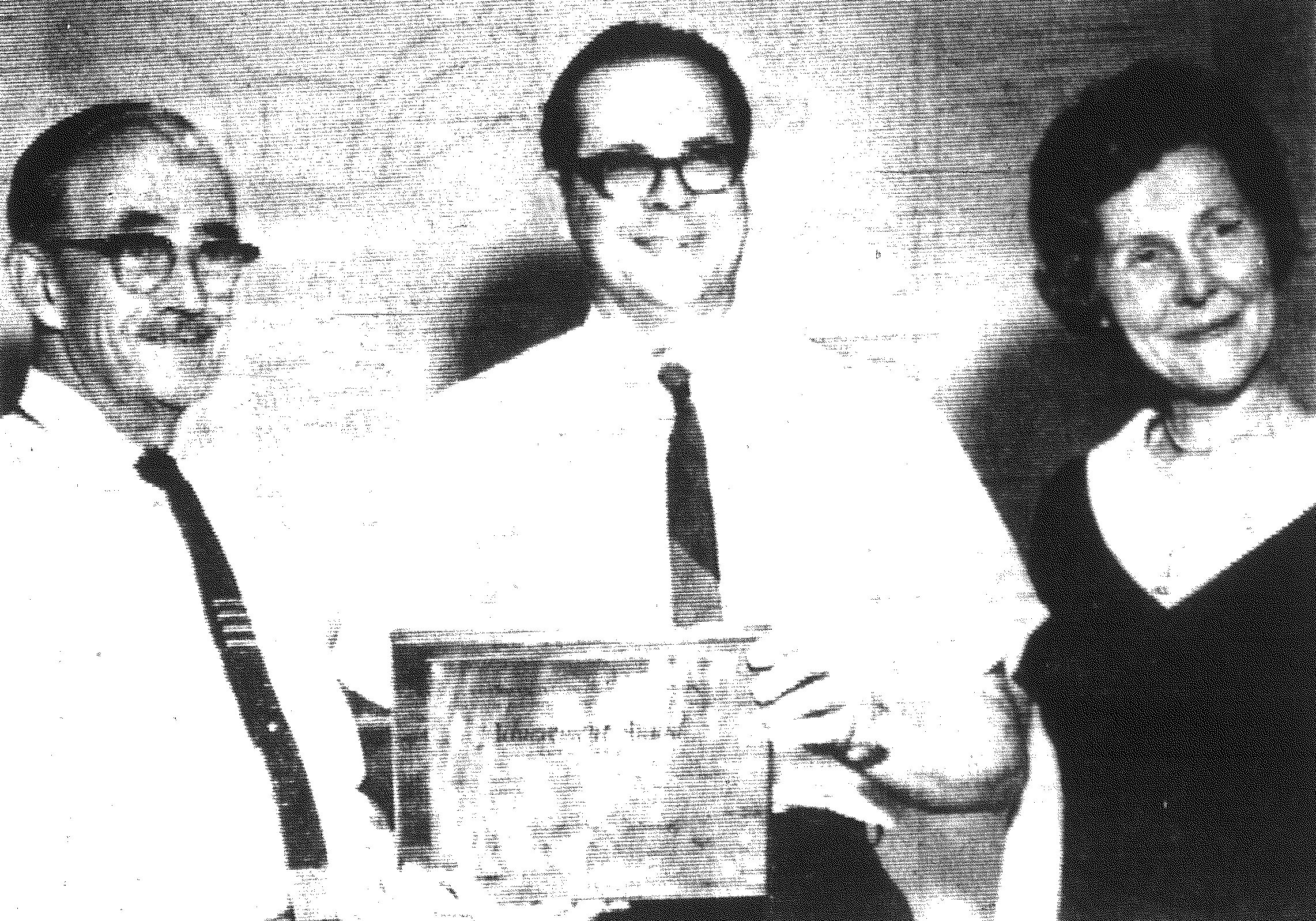 1967 - M.R. Newton, center, who heads the Sumter Child Study Project, proudly displays the plaque signifying the project as the American Psychiatric Assn's Gold Achievement Award first-place winner. At left is John Godbey, chairman of the District 17 school board, while Mrs. Nell Dabbs, psychiatric social worker with the project, is on the right.