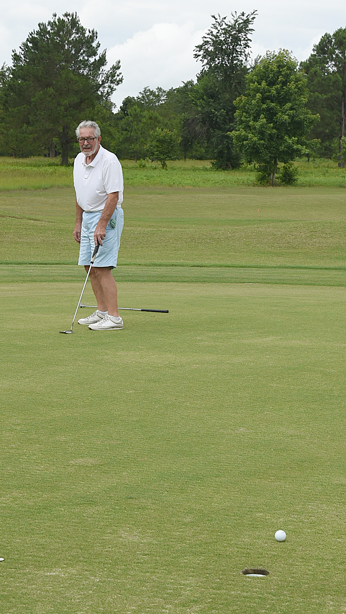 Jack Henson watches a long putt Friday at Wyboo Golf Club near Manning. A housing development called Deercreek at Wyboo offers homes for sale along the fairways.