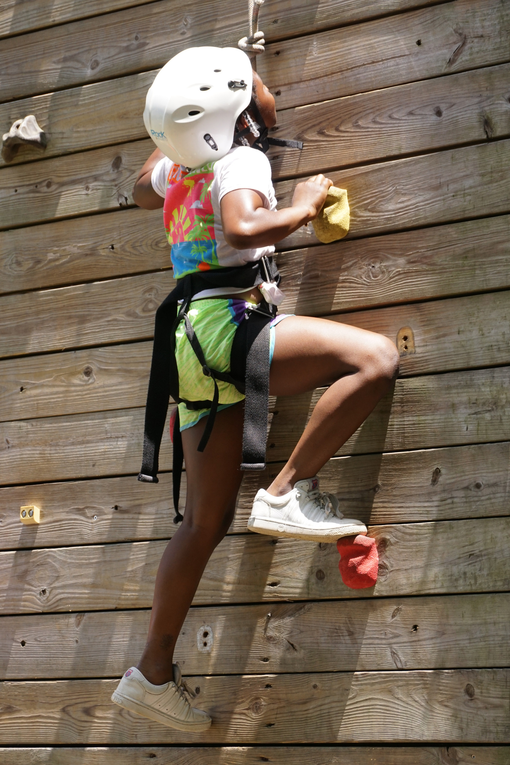 A camper scales the climbing wall at Camp Bob Cooper Wednesday at Camp Happy Days. The climbing wall offers the campers a chance to do something they have never done before and get encouragement from their peers, said Camp Happy Days Executive Director Cindy Johnson.
