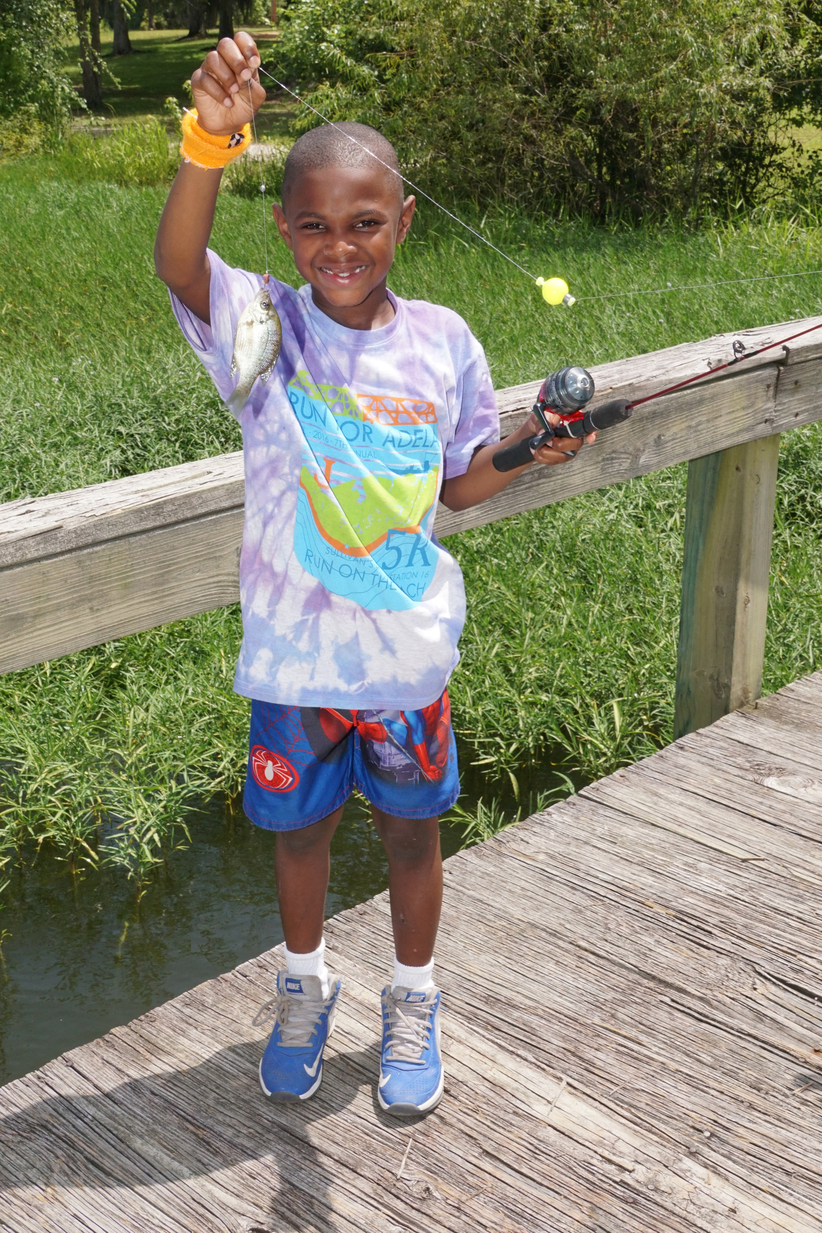 A camper shows off the fish he caught Wednesday.