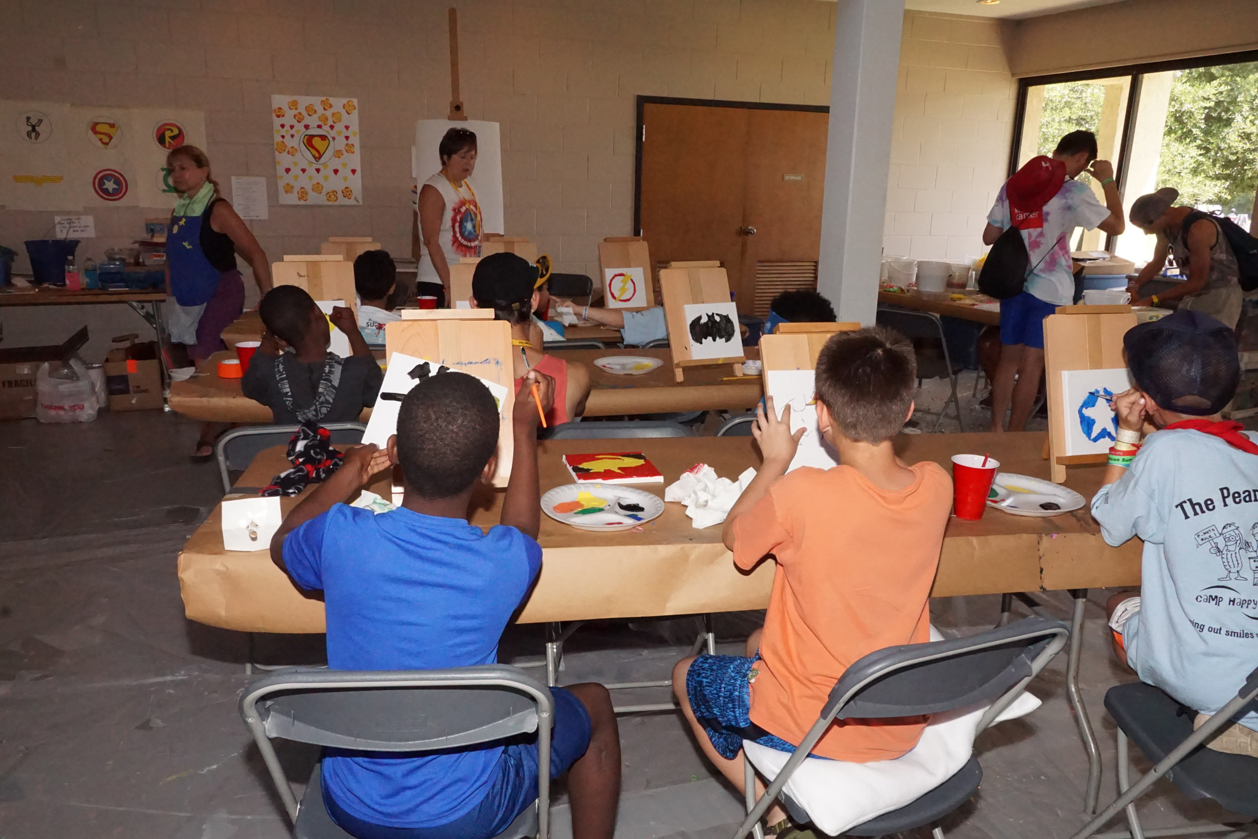 Art lessons are among the indoor activities for Camp Happy Days participants.