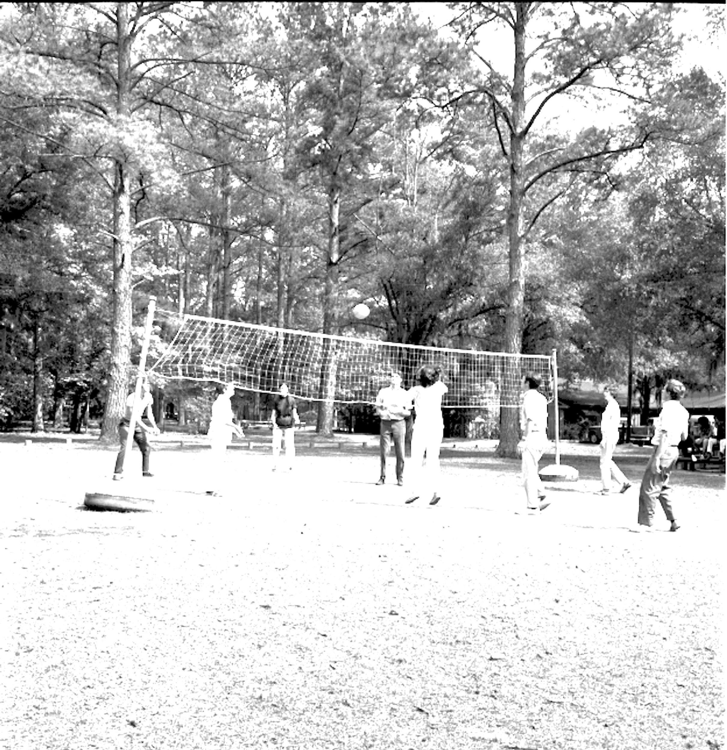 Visitors play volleyball on the Poinsett playground.